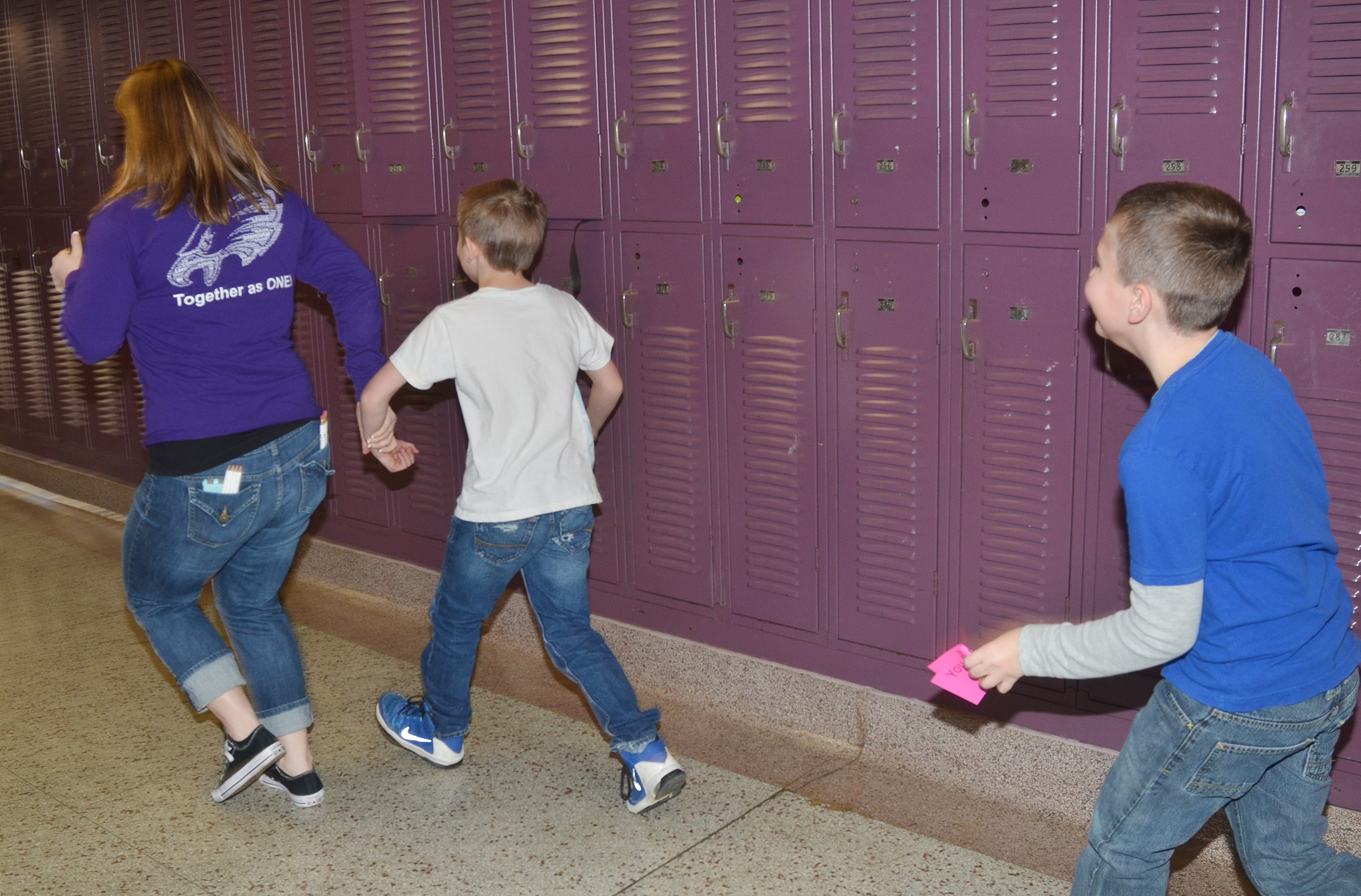 CMS teacher Katie Campbell helps fourth-graders Arthur Singleton, at left, and Michael Abel as they travel the Underground Railroad in their school hallways to freedom.
