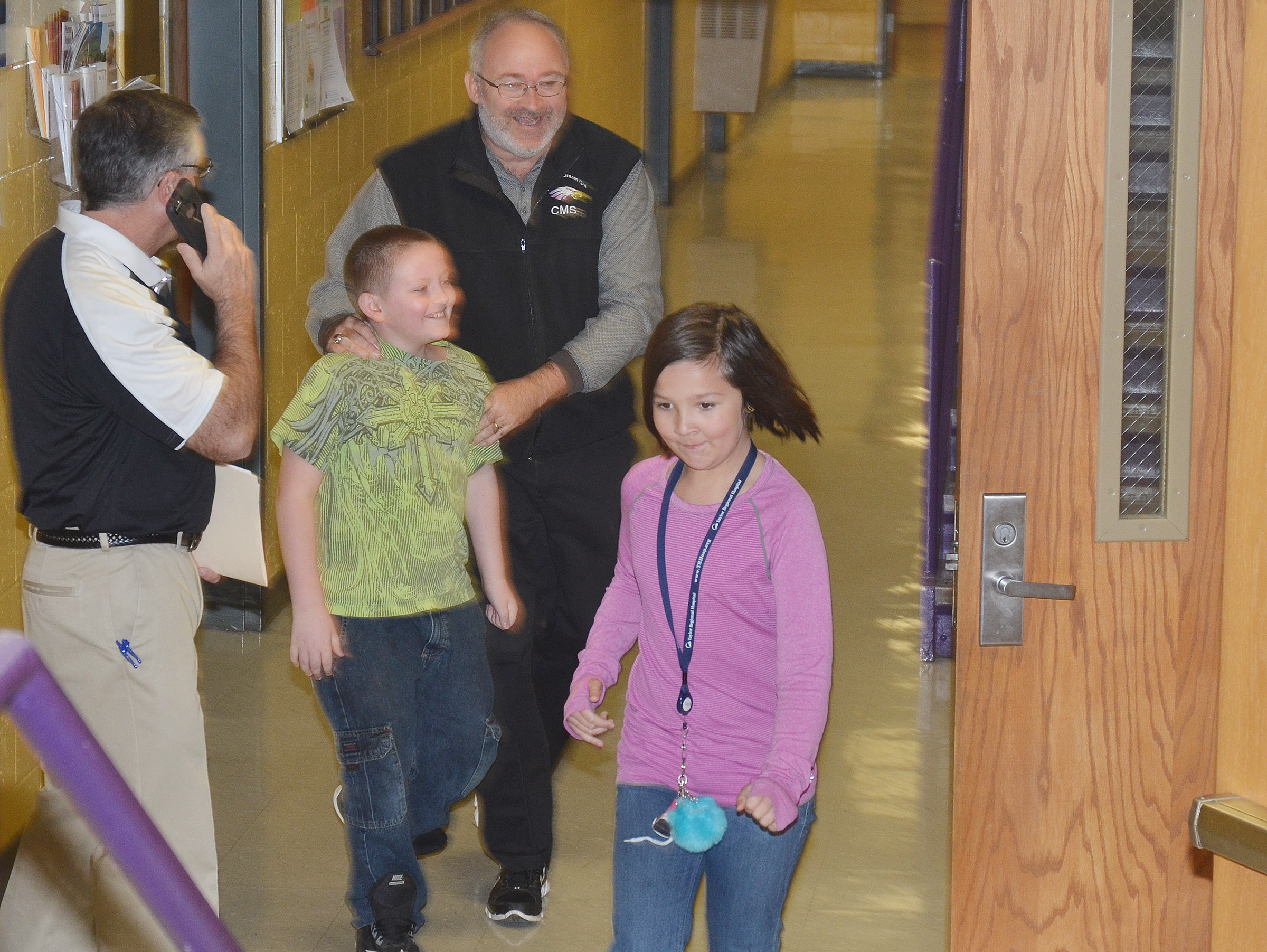 CMS Assistant Principal Tim Bailey captures fourth-graders Christopher Cox and Cassie Crick as they try to make their way to safety via the Underground Railroad in their school hallways.