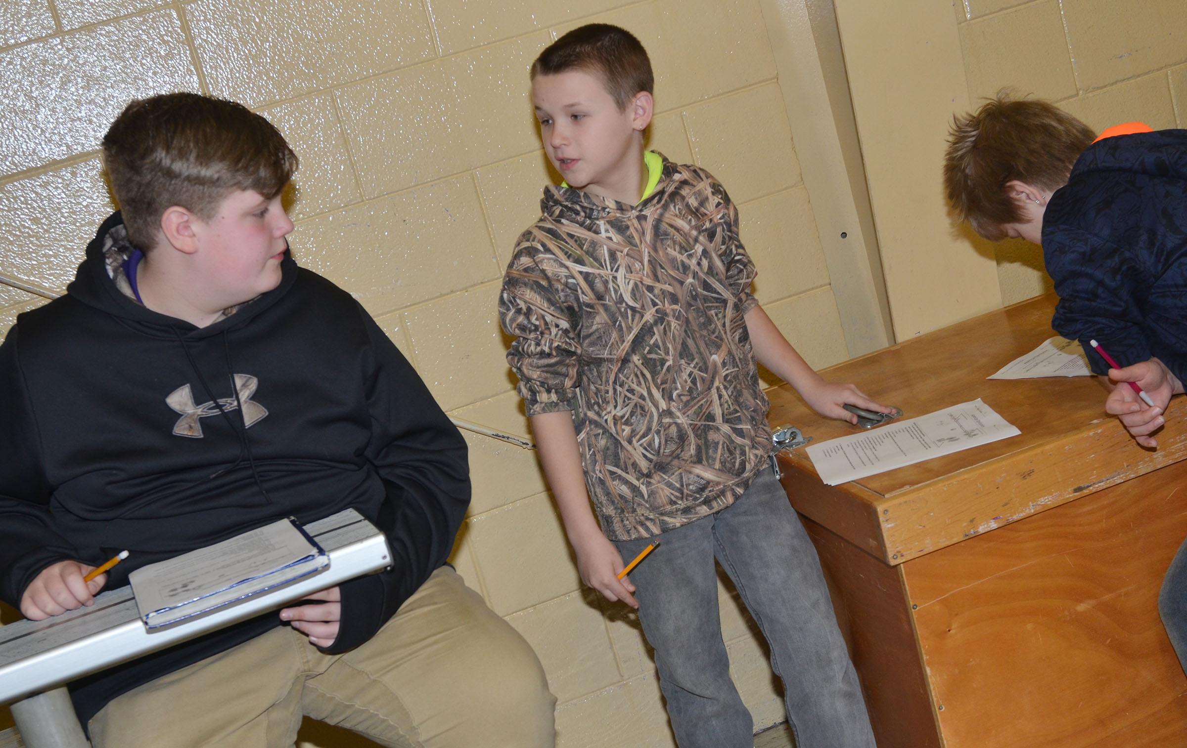 CMS fifth-grader Kasey Sluder, at right, works with eighth-grader Noah Mardis to answer questions about the American Revolution.