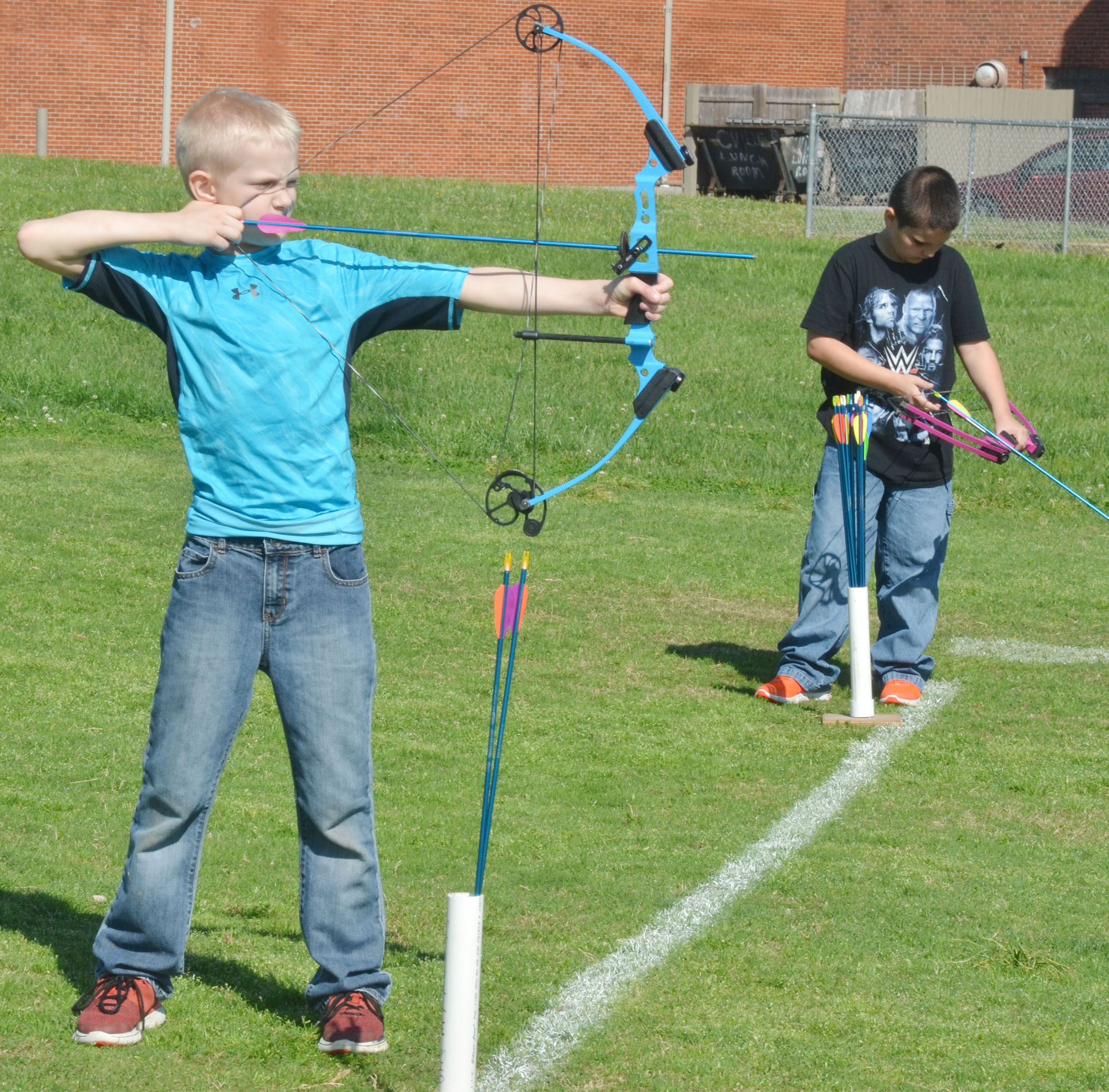CMS fourth-grader Bronson Cox, at left, and Chase Gabehart take aim.