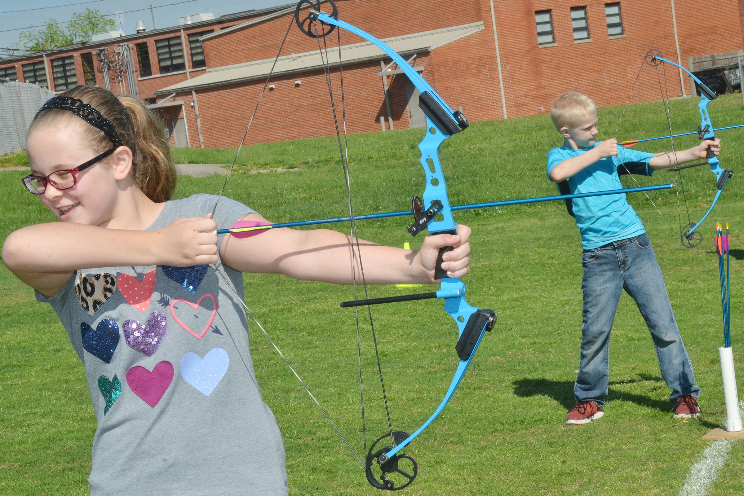 CMS fifth-grader Karlie Cox takes aim.