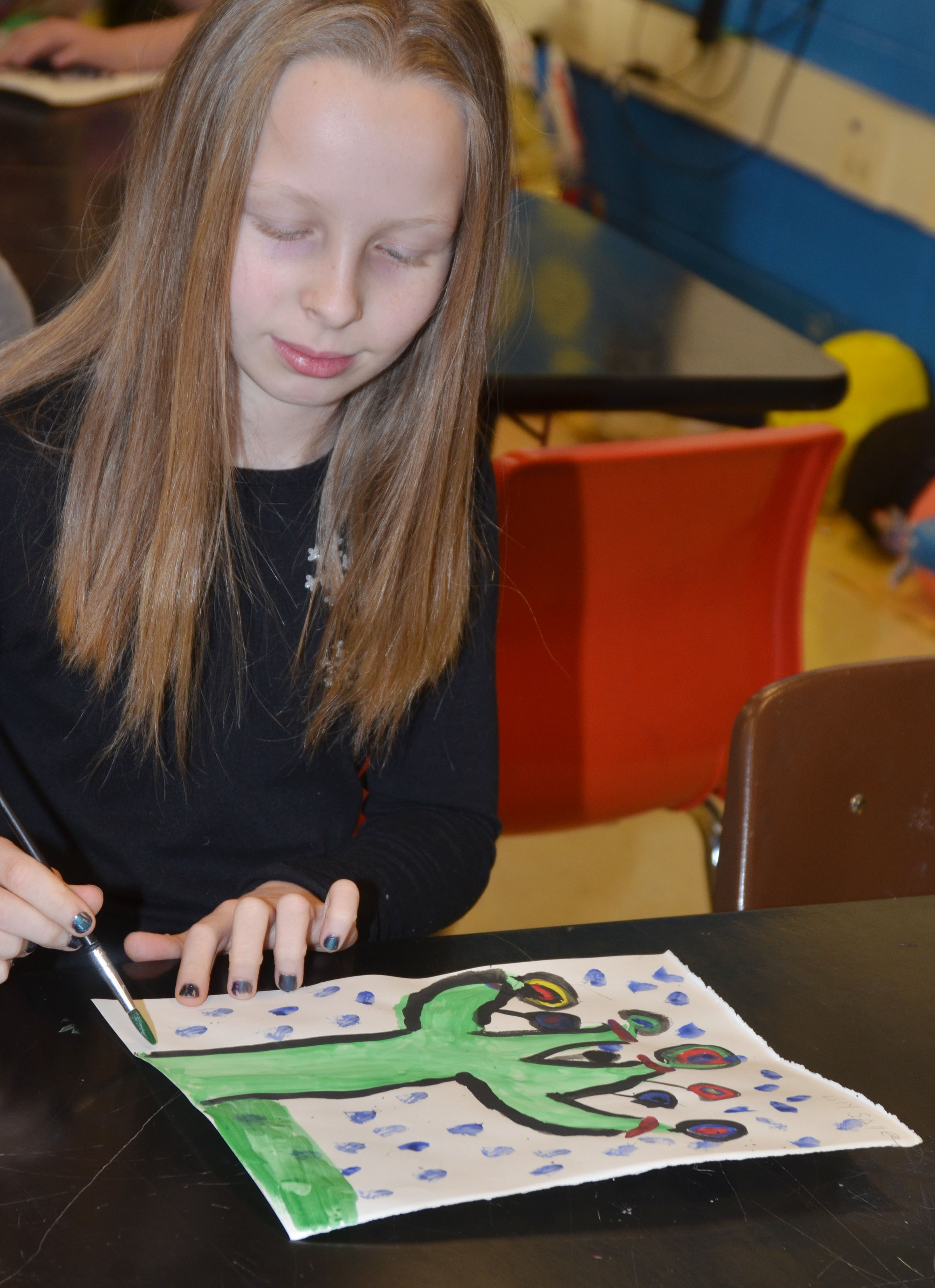 CMS fourth-grader Lily Sallee works on her concentric circle painting.
