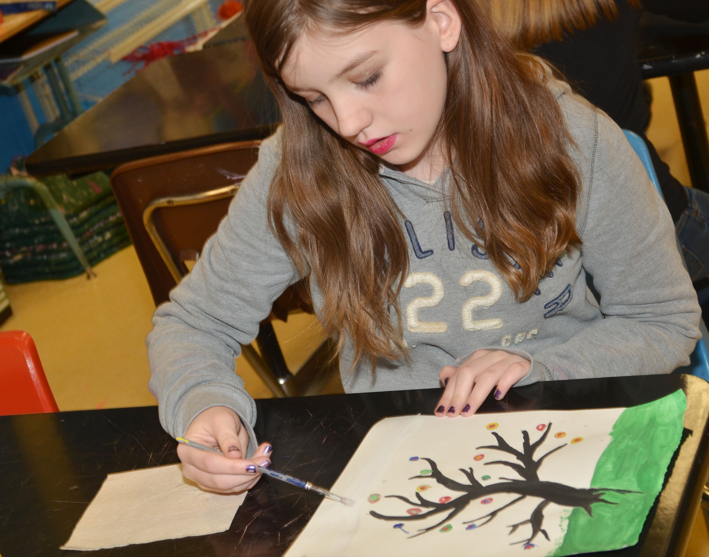 CMS sixth-grader Mikaela Scharbrough works on her concentric circle painting.