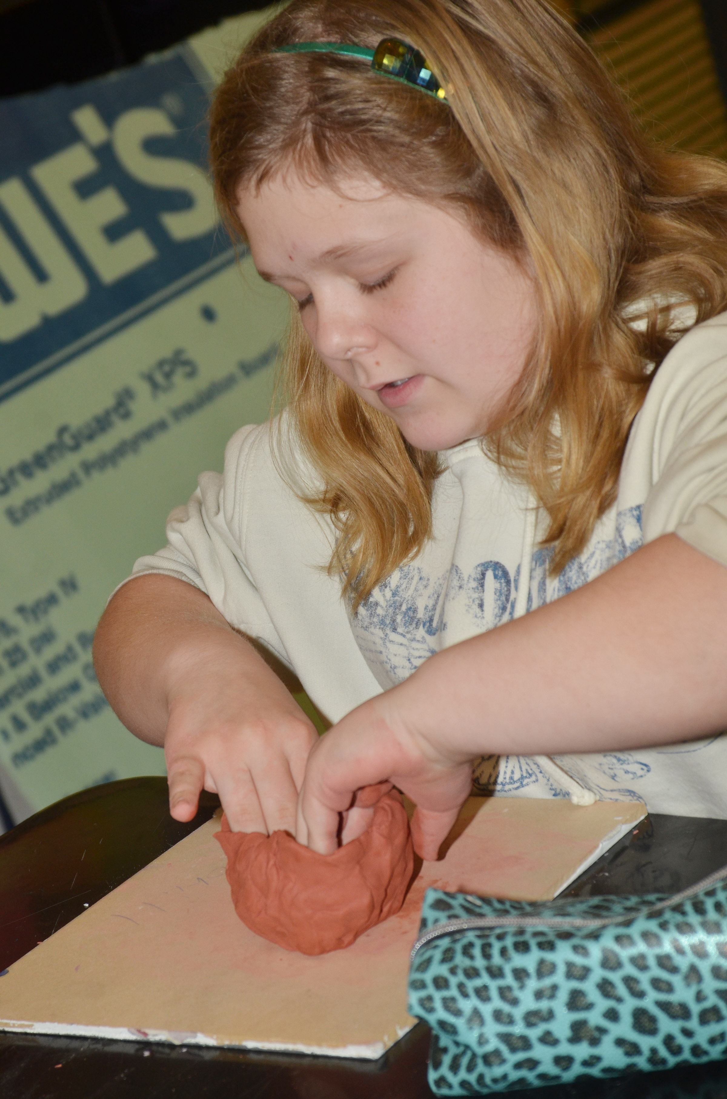 CMS sixth-grader Alexis Sharp makes a pot out of clay.