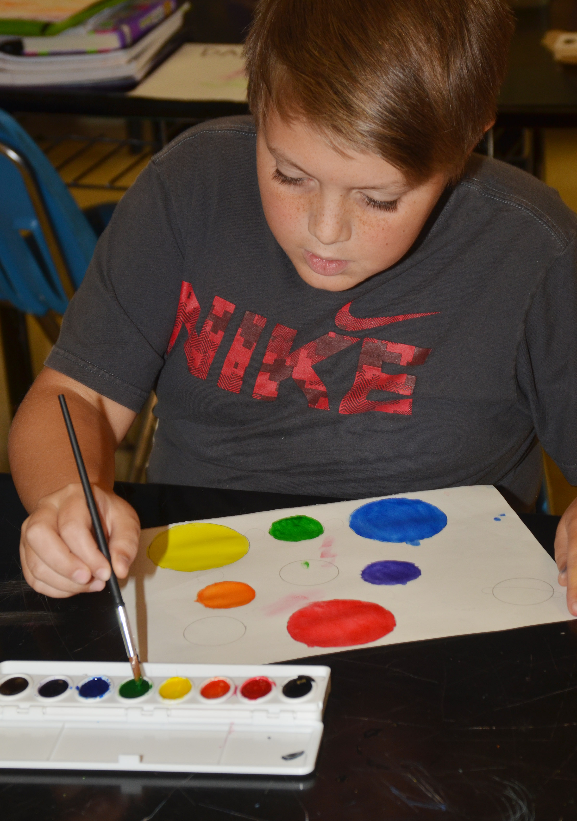 CMS sixth-grader Nathan Ray paints his color wheel.