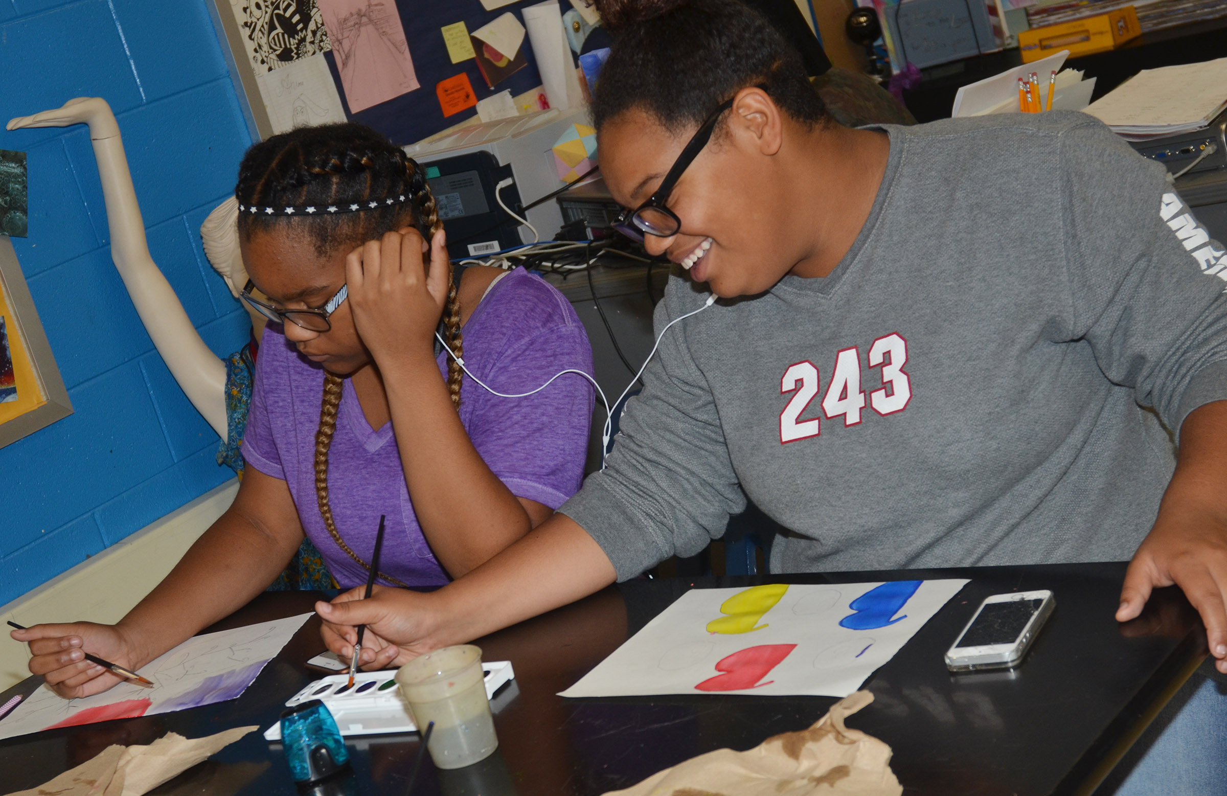 CMS seventh-grader Antaya Epps, at left, and eighth-grader Brae Washington paint their color wheels.