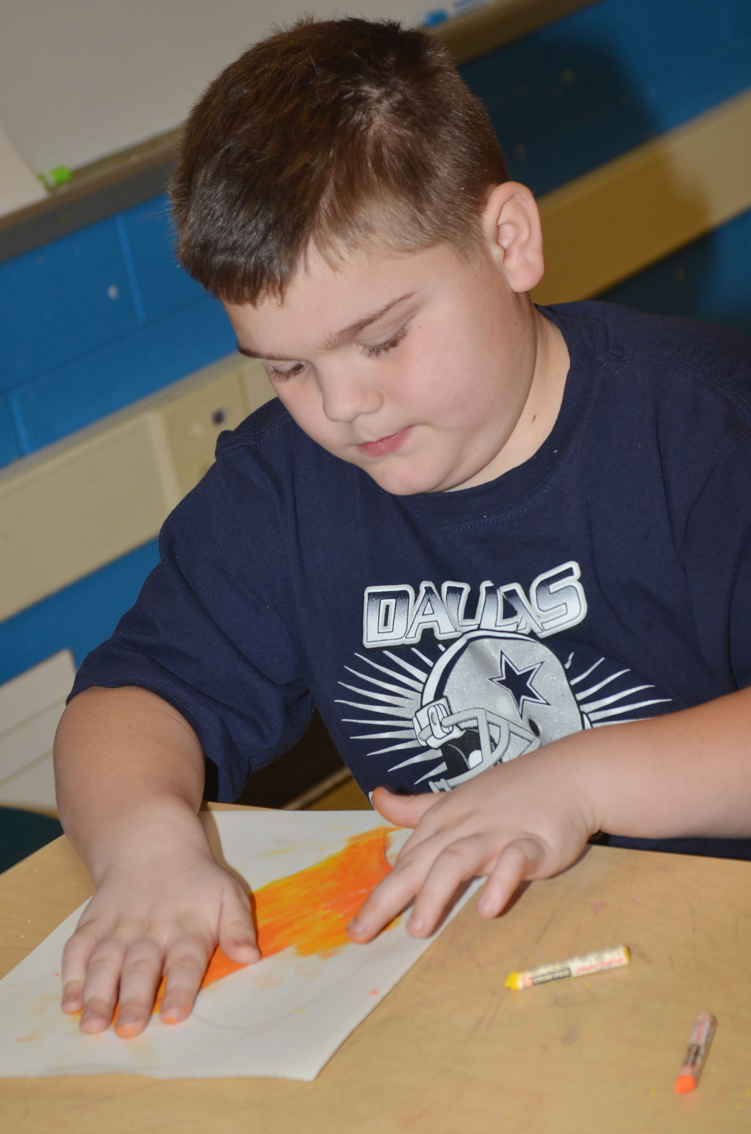 CMS fourth-grader Logan England colors his heart.