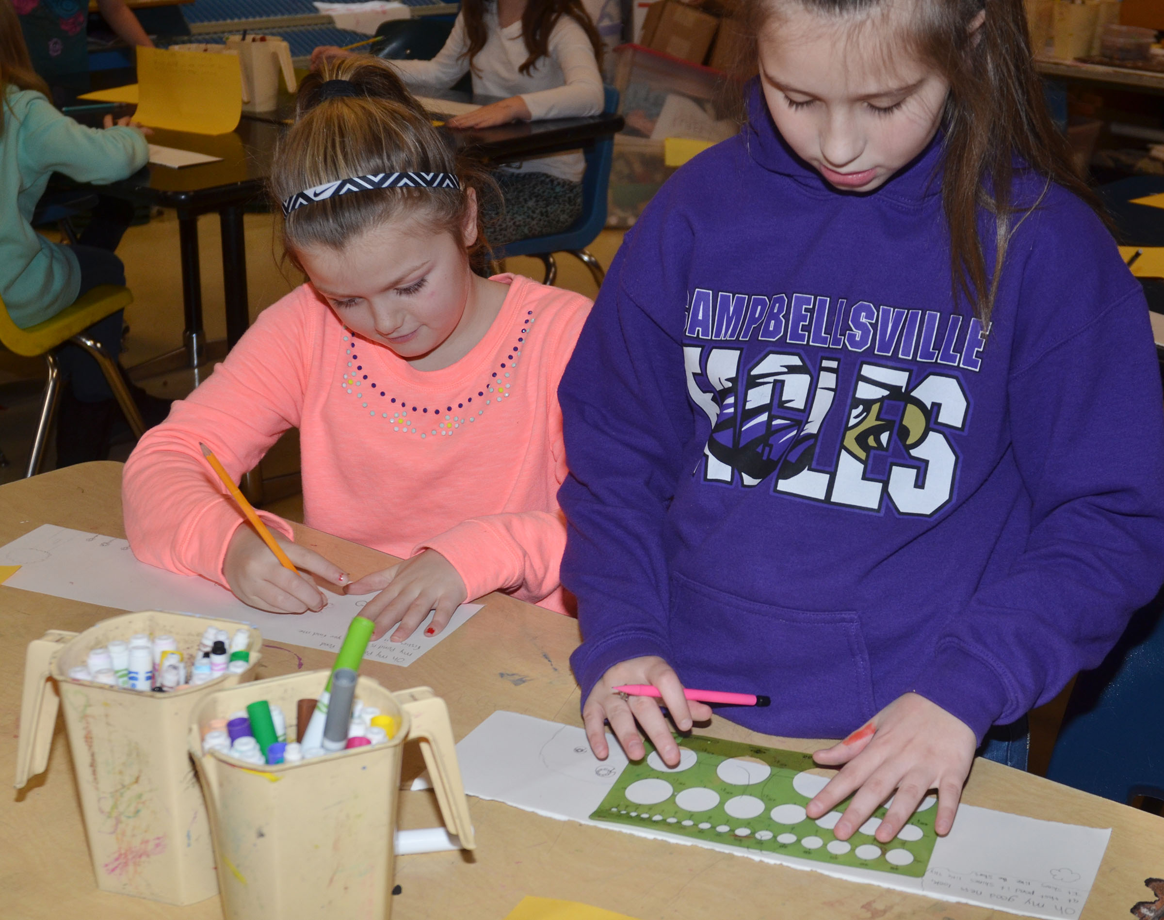 CMS fifth-graders Ellington Gowin, at left, and Mollie Bailey illustrate their haikus.