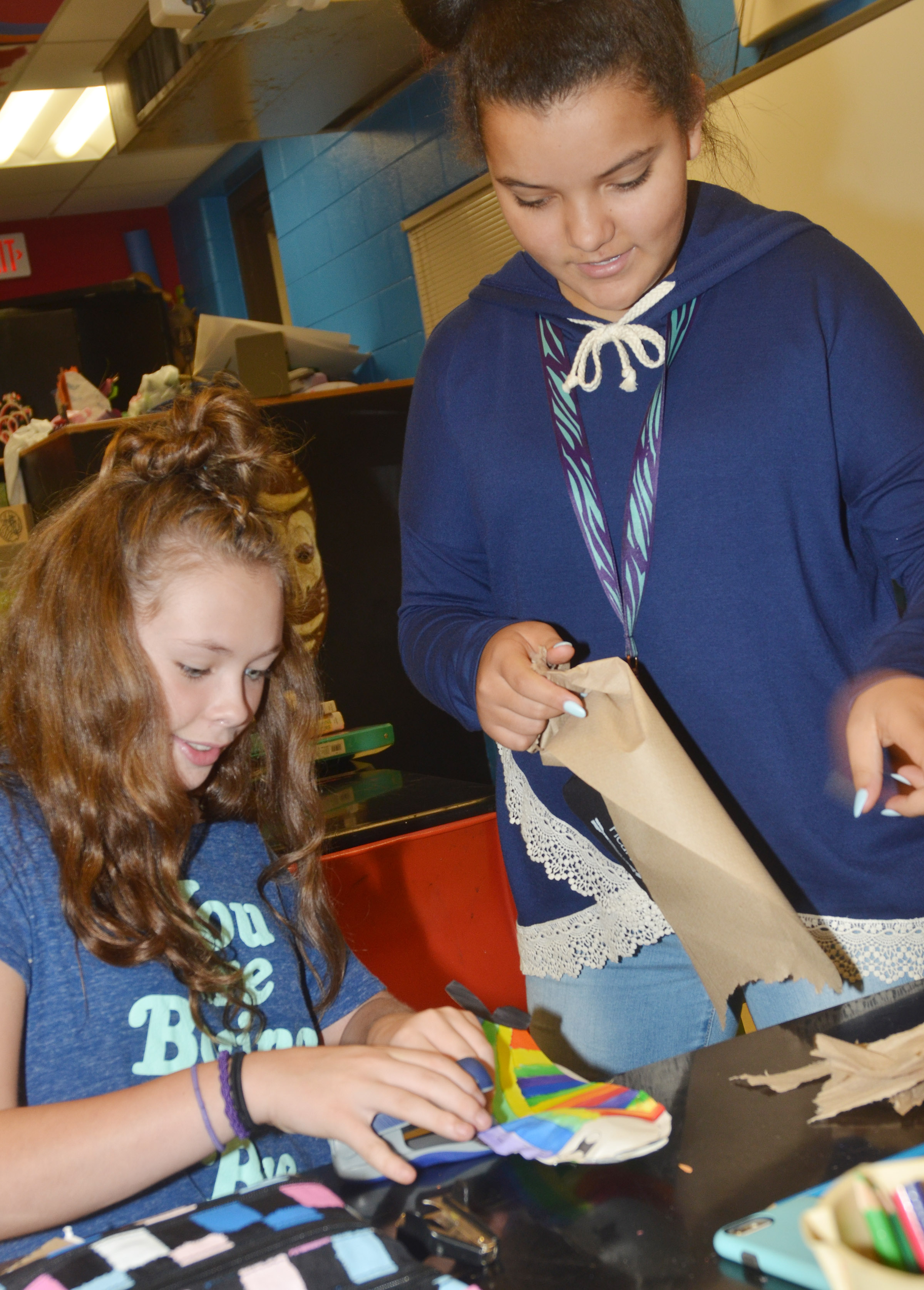CMS sixth-graders CheyAnn Edwards, at left, and Gracie Taylor stuff their koinobori.