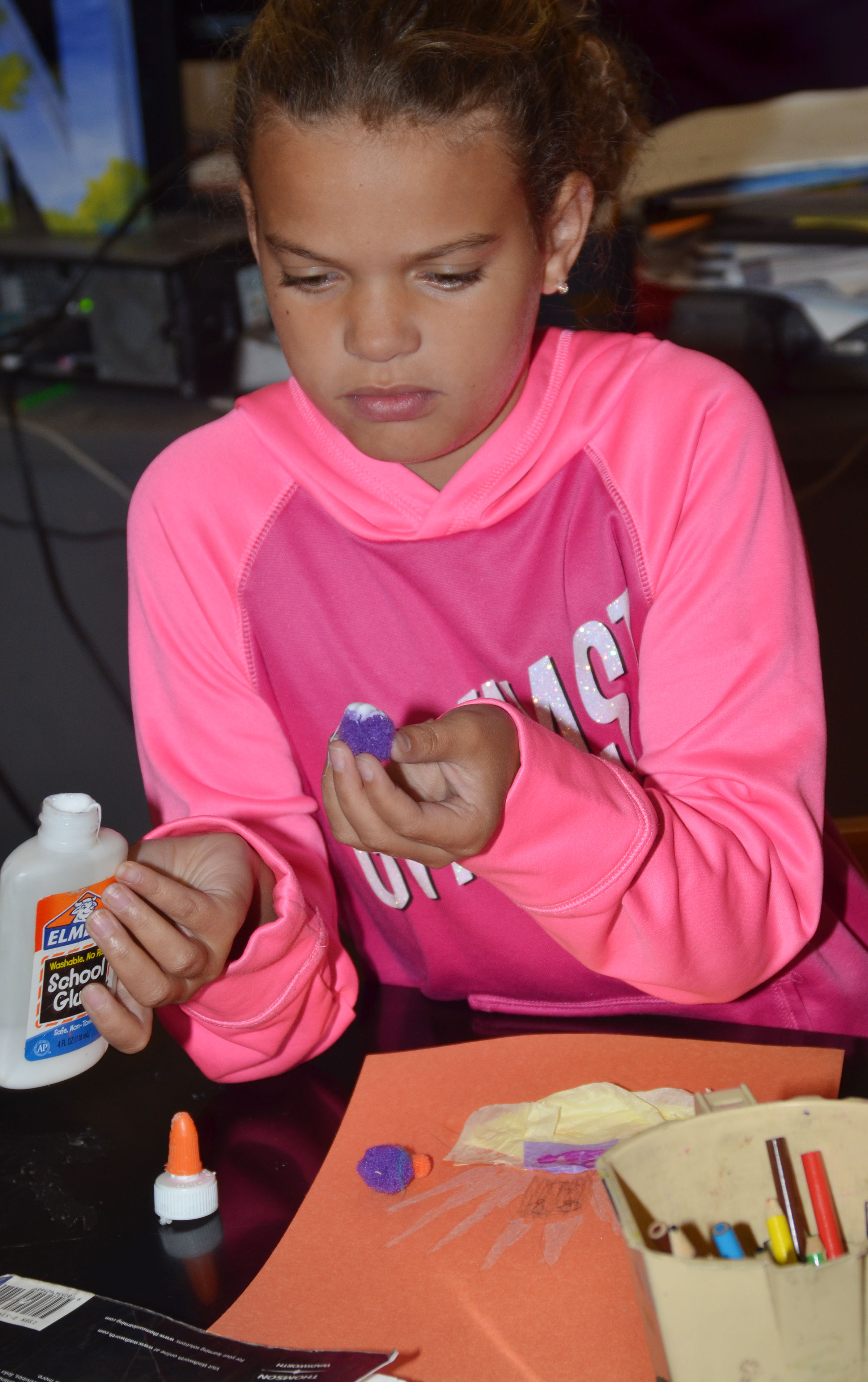 CMS fifth-grader Arisha Francis uses craft supplies to disguise her turkey.