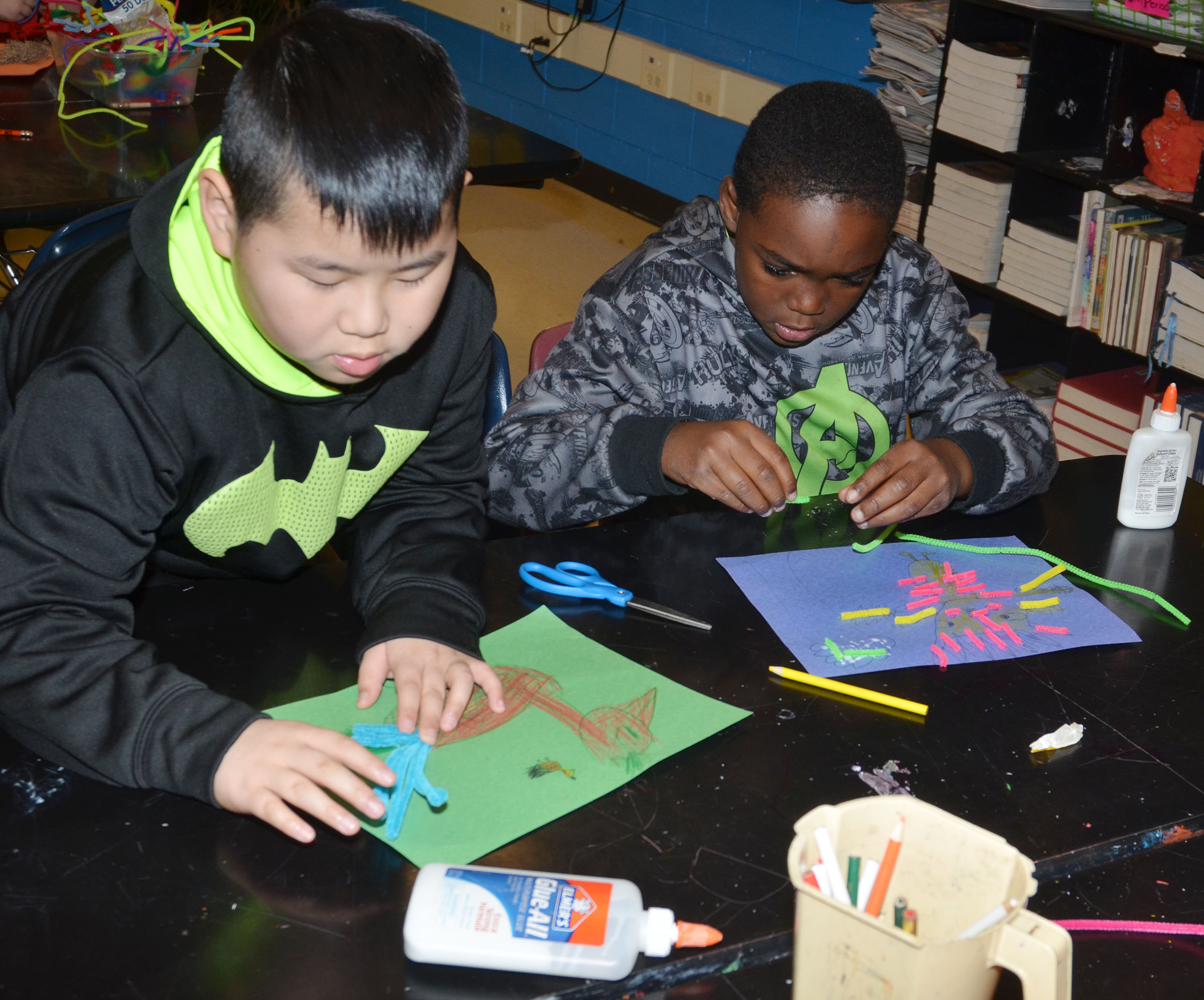 CMS fourth-graders Zhi Chen, at left, and Deason Smith disguise their turkeys with pipe cleaners.