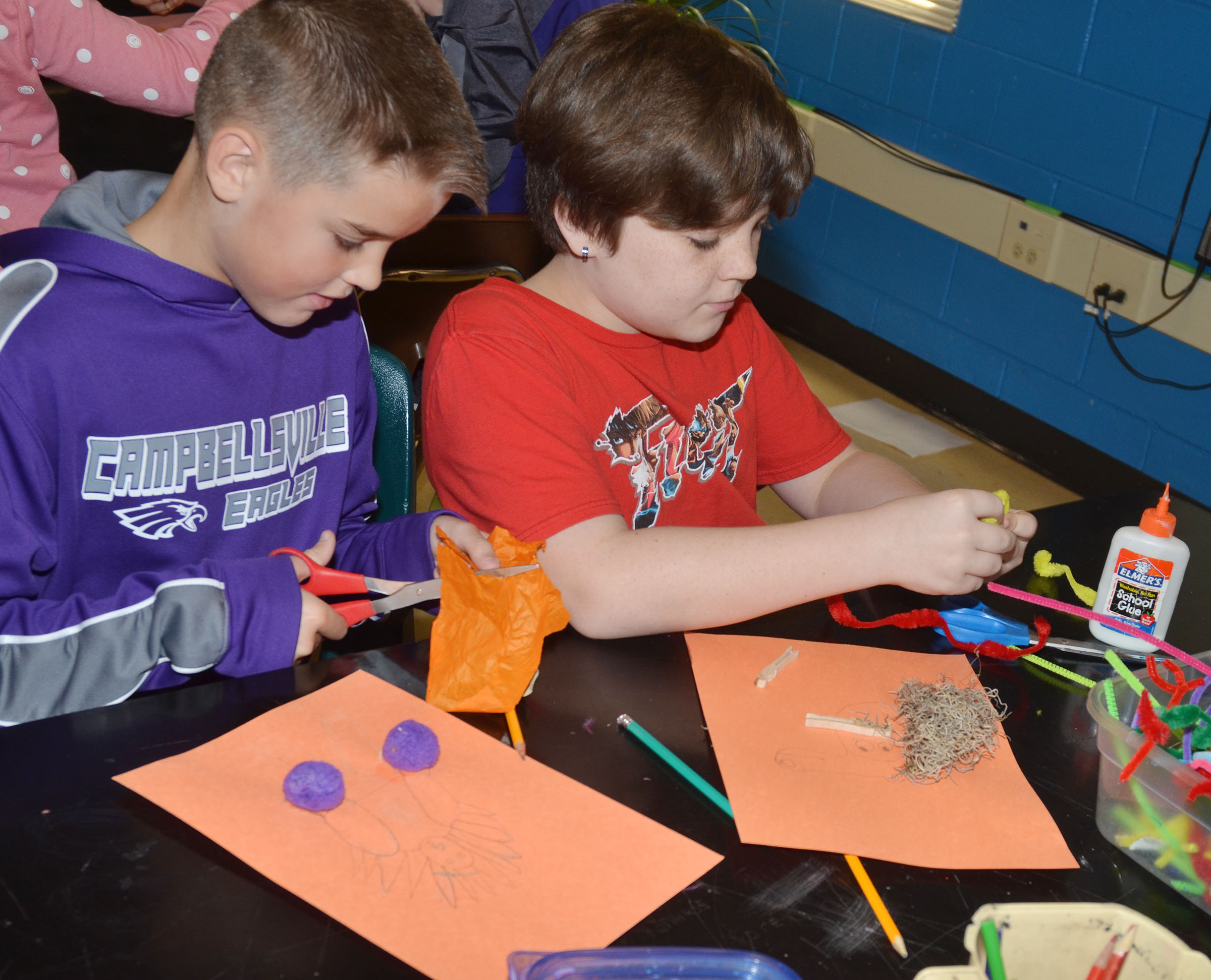 CMS fifth-graders Kaden Bloyd, at left, and Kayden Birdwell disguise their turkeys.
