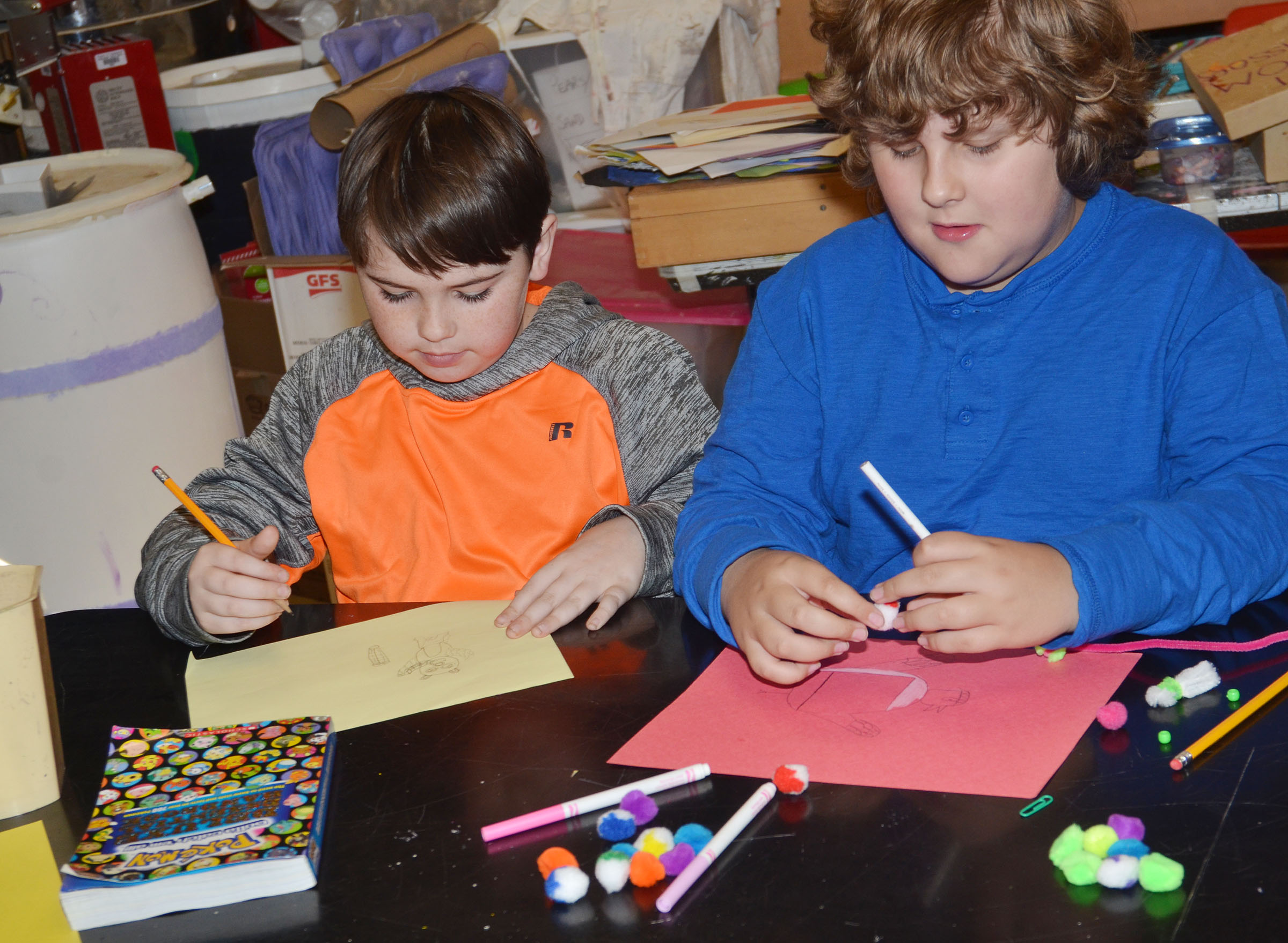 CMS fourth-graders Cody Agee, at left, and Zeke Harris draw their turkeys.