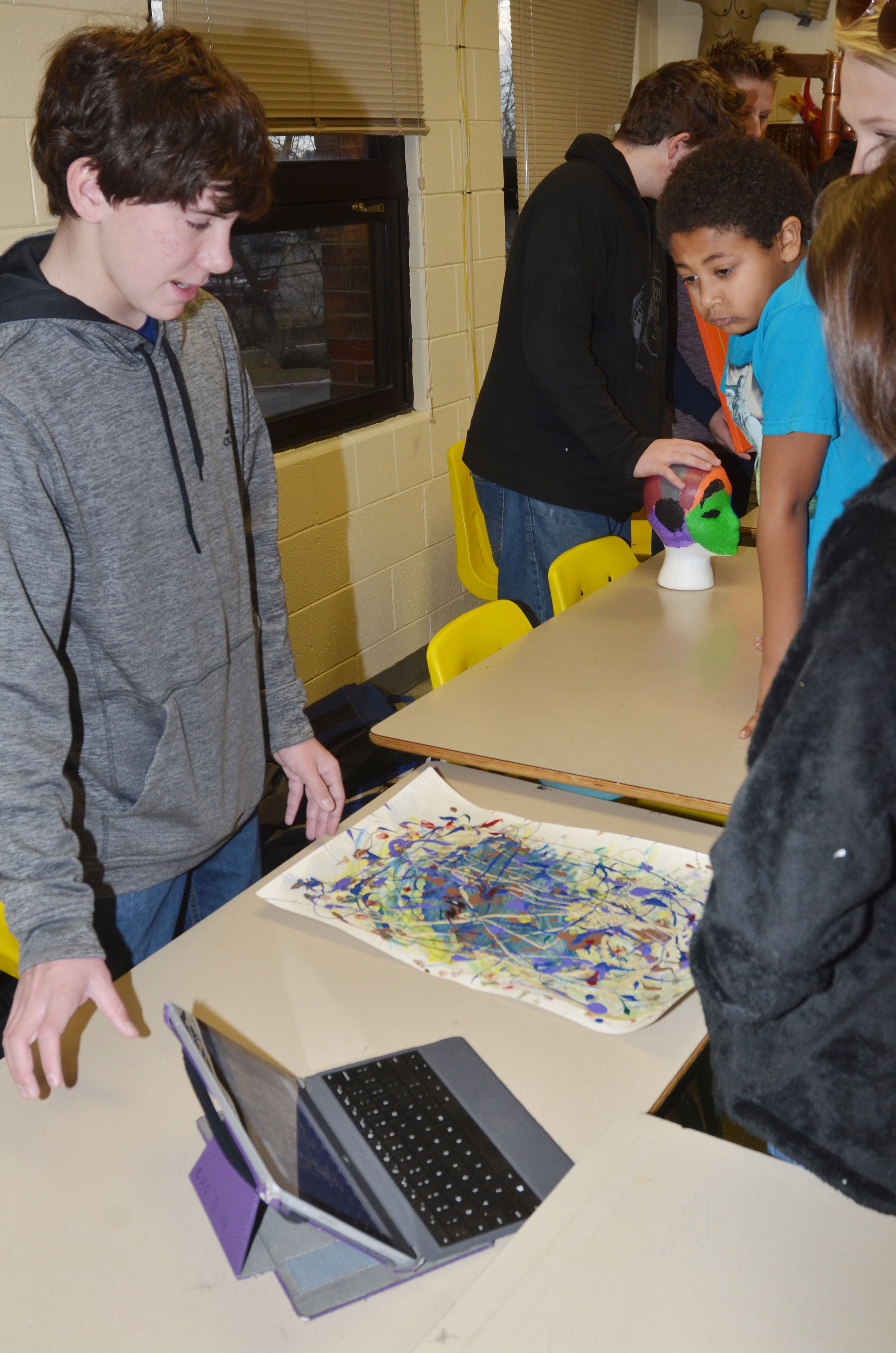 CMS seventh-grader Peyton Dabney displays his artwork.