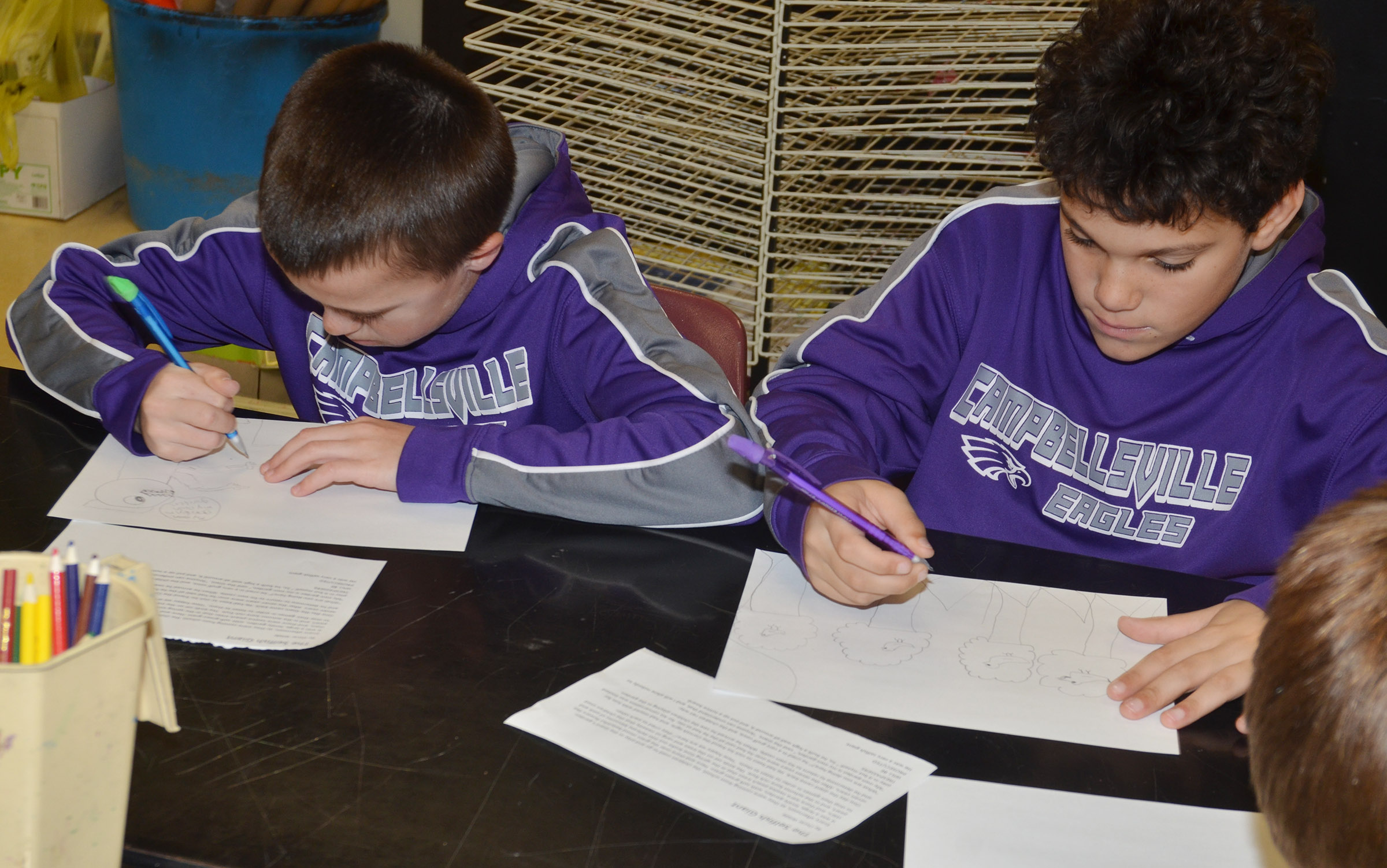 "CMS sixth-graders Chase Hord, at left, and Kaydon Taylor draw a pictured based on the story ""The Selfish Giant"" by Oscar Wilde."