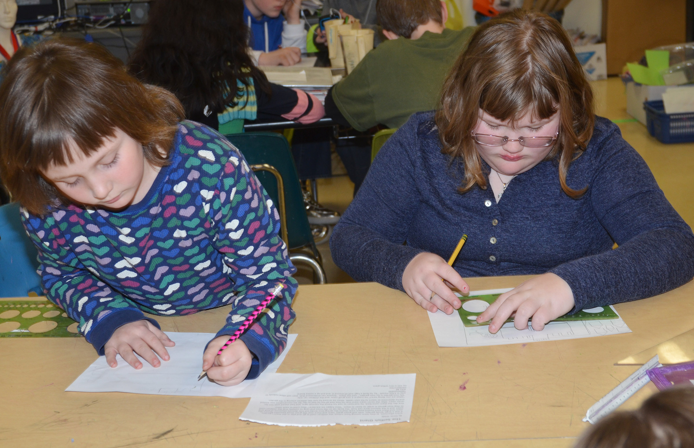 "CMS fifth-graders Angel Walker, at left, and Katlin Rainwater draw a pictured based on the story ""The Selfish Giant"" by Oscar Wilde."