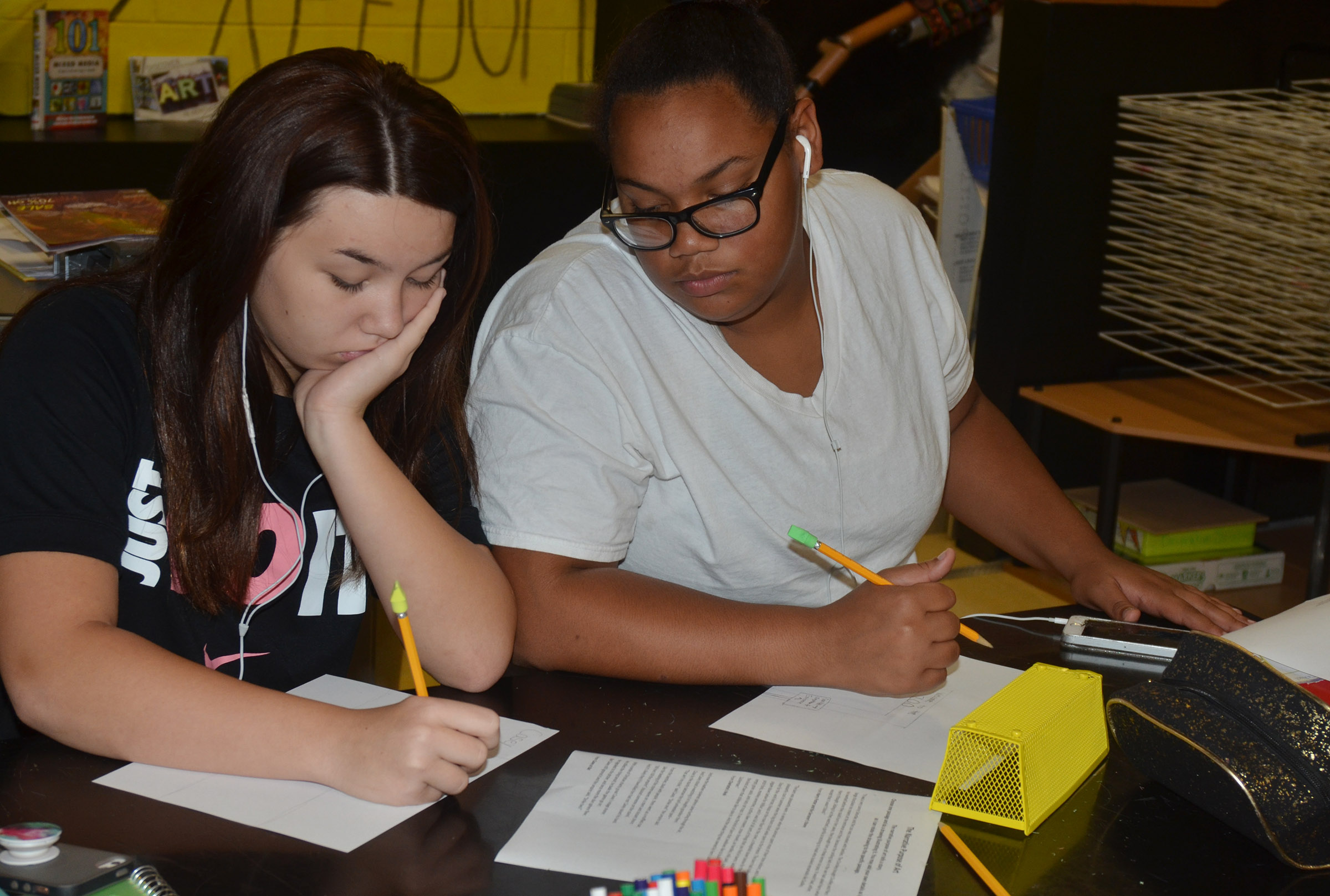 CMS eighth-graders Olivia Fields and Brae Washington sketch their drawings.