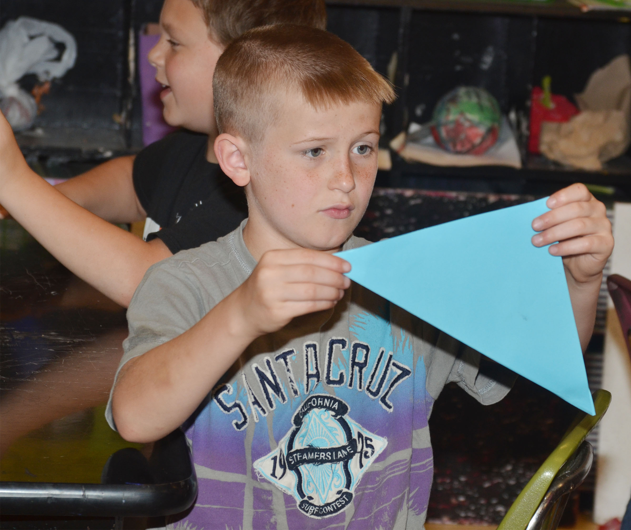 CMS fourth-grader Arthur Singleton makes his crane.