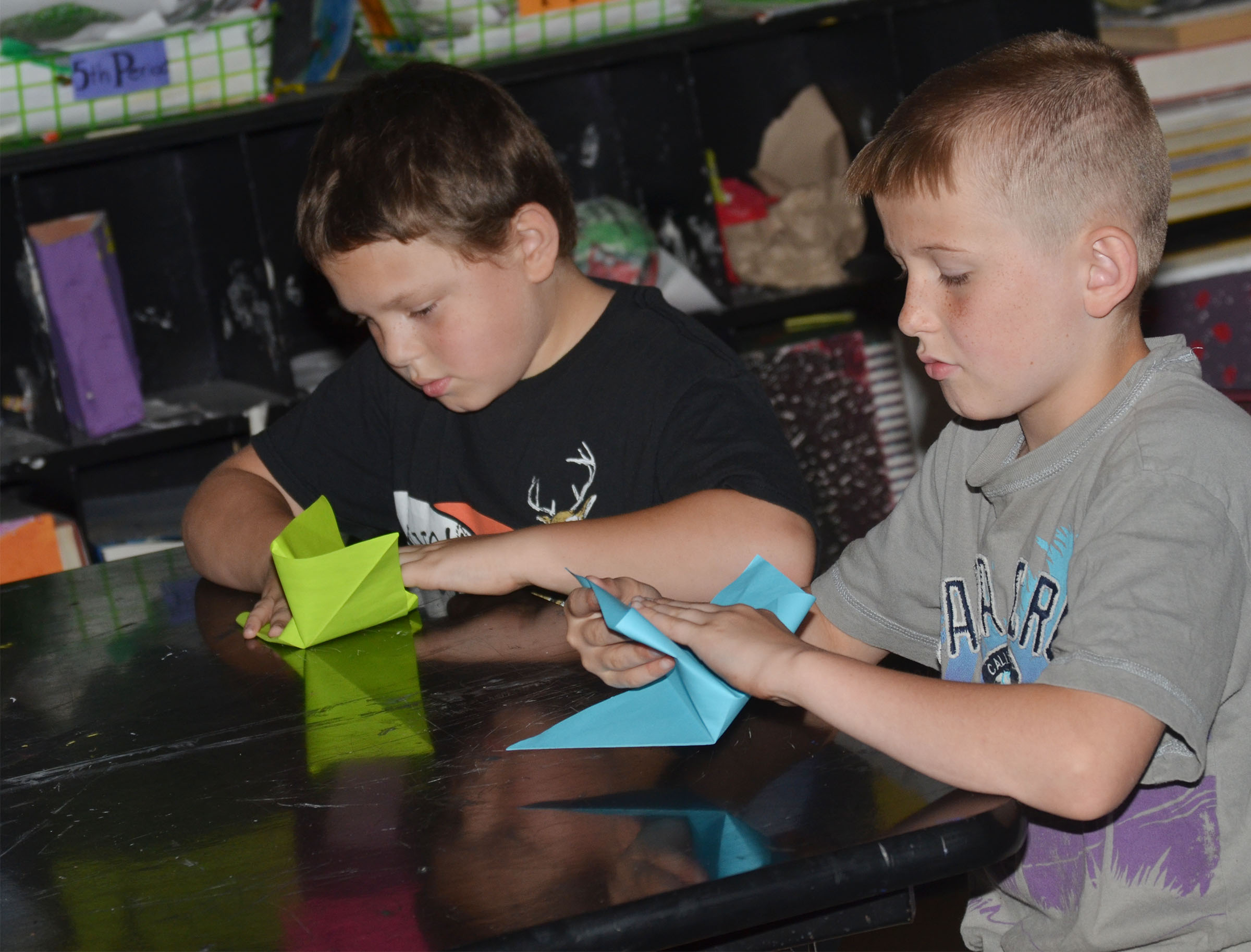 CMS fourth-graders Ethan Marrs, at left, and Arthur Singleton make their cranes.