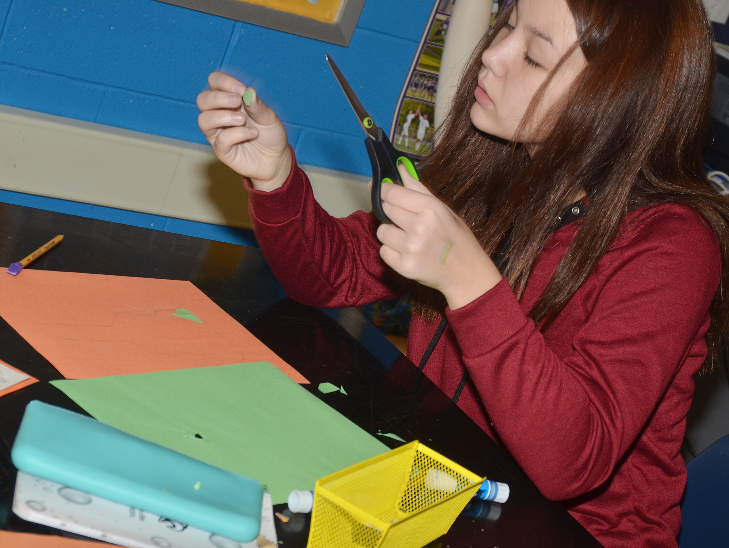 CMS eighth-grader Olivia Fields makes her collage.