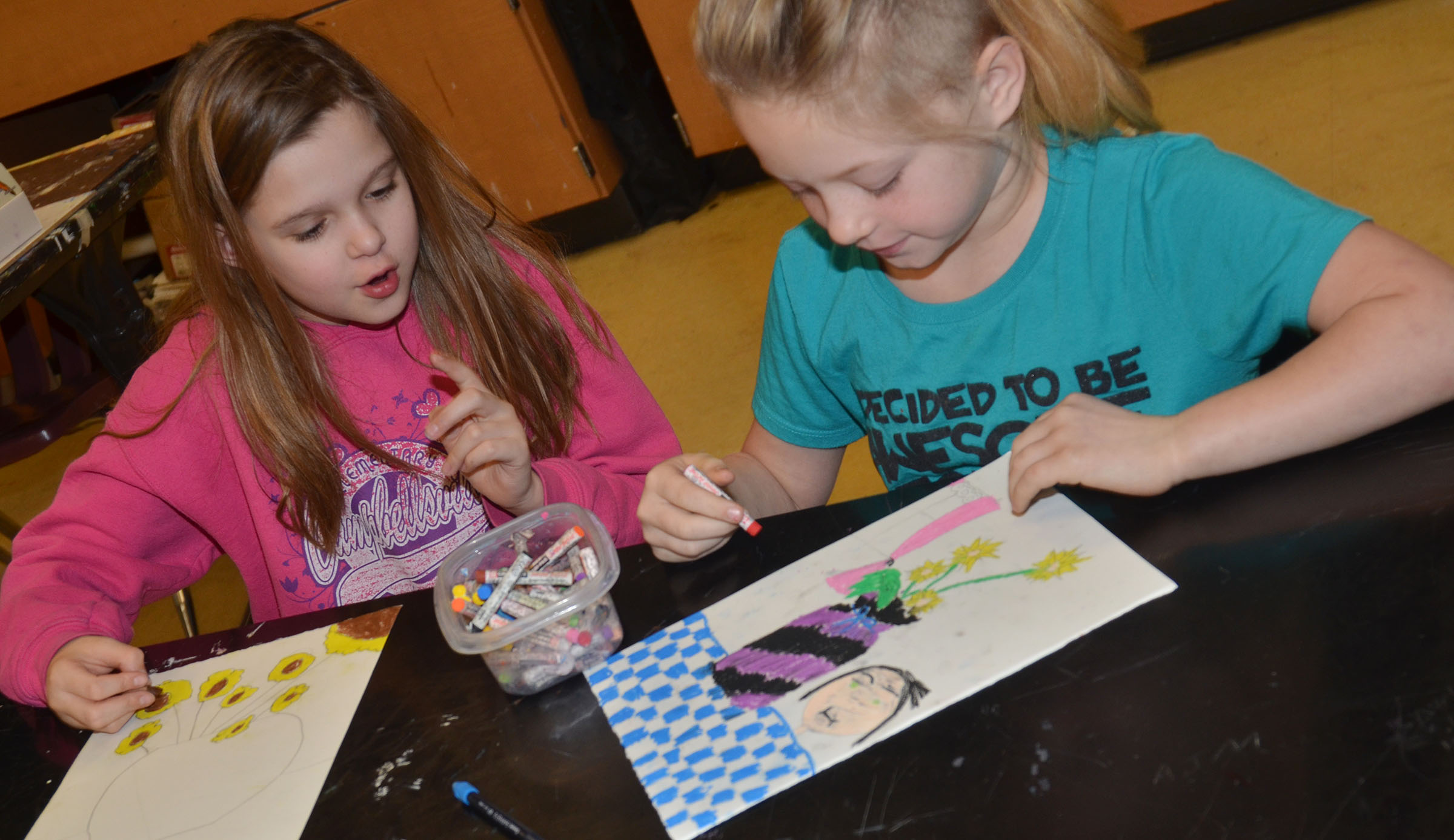 CMS fourth-graders Natasha Torres, at left, and Kyra Parker color their sunflower drawings.