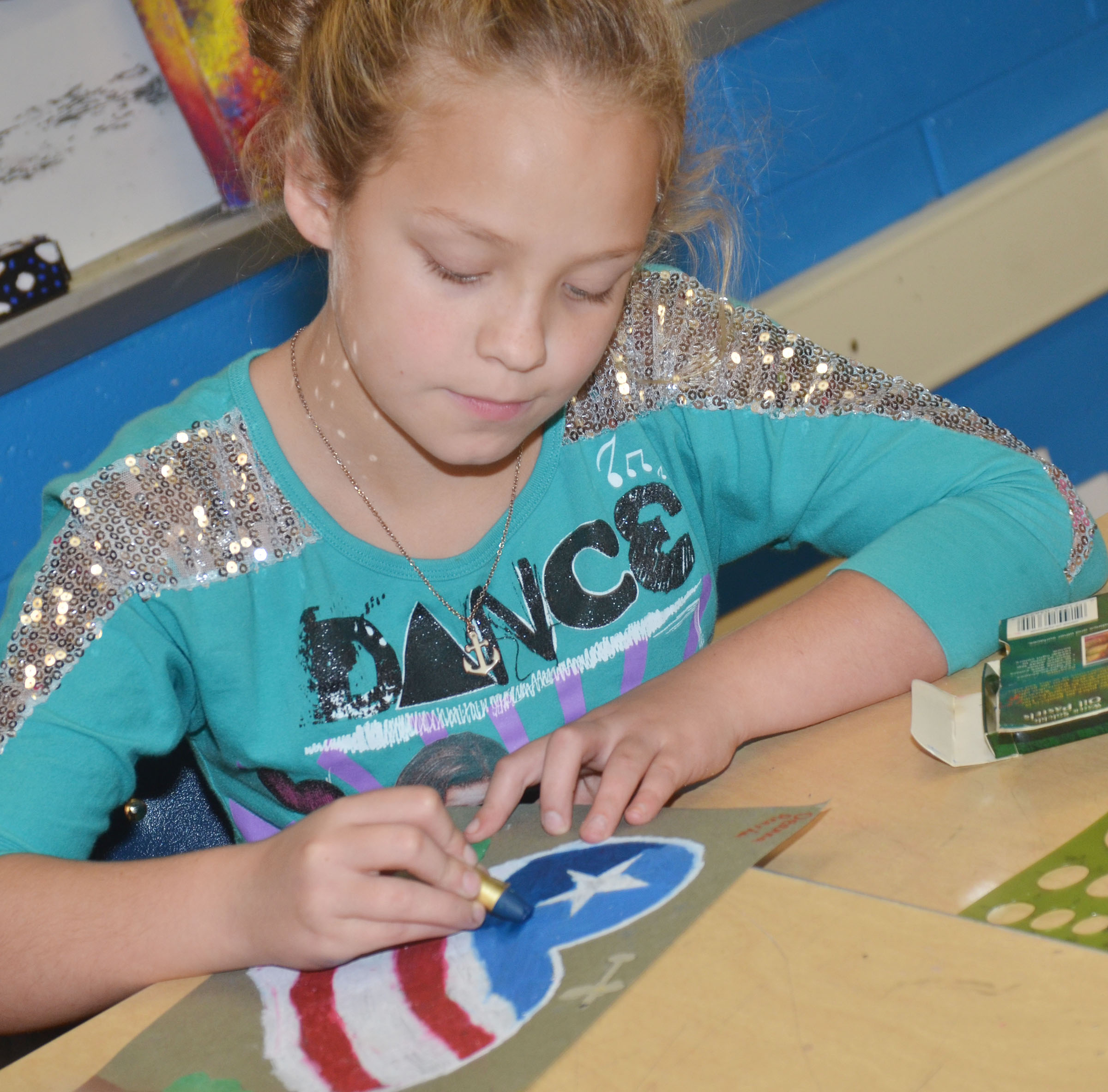 CMS fourth-grader Deanna Reardon adds color to her patriotic heart.