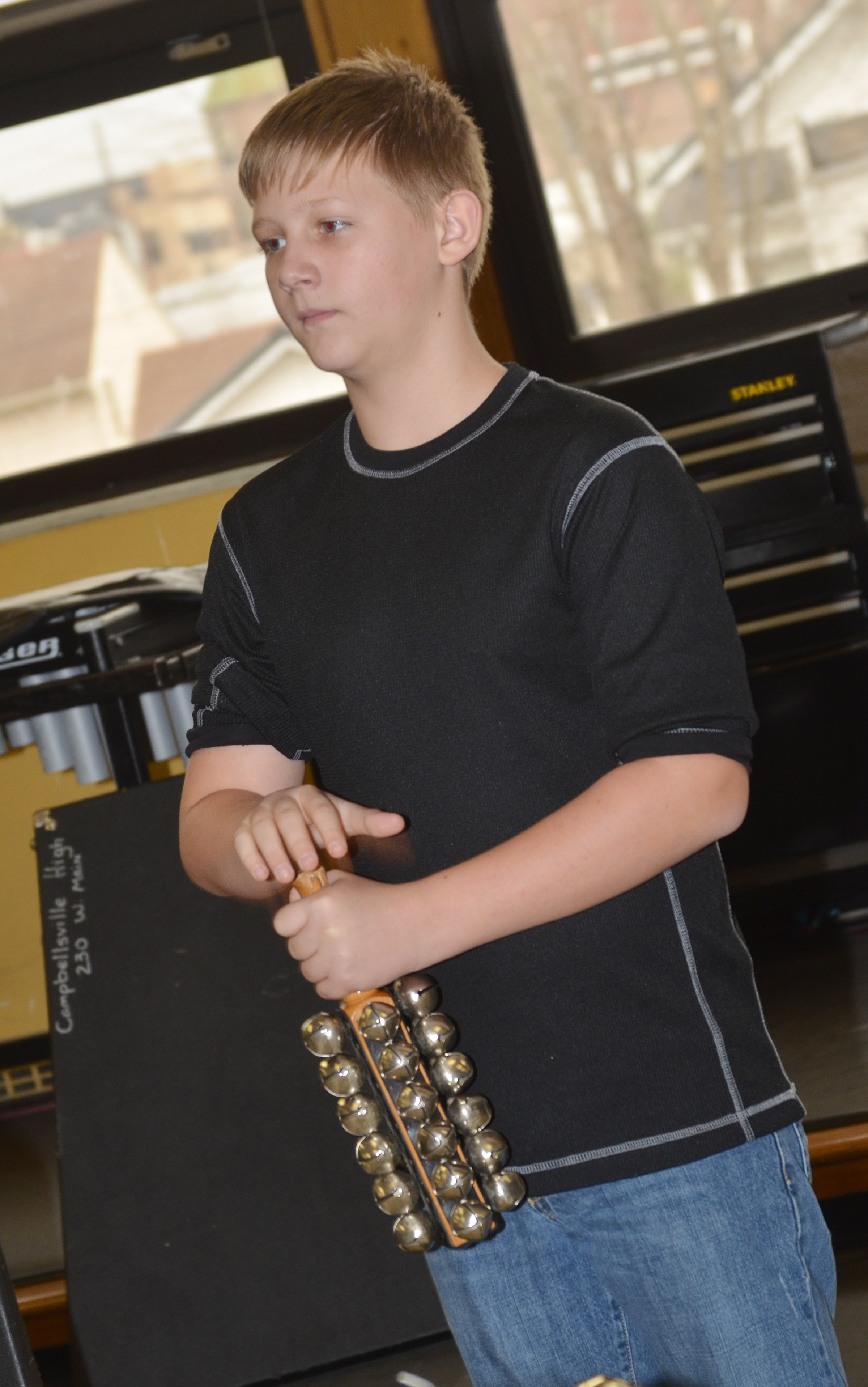 CMS sixth-grader Jesse King plays the bells.