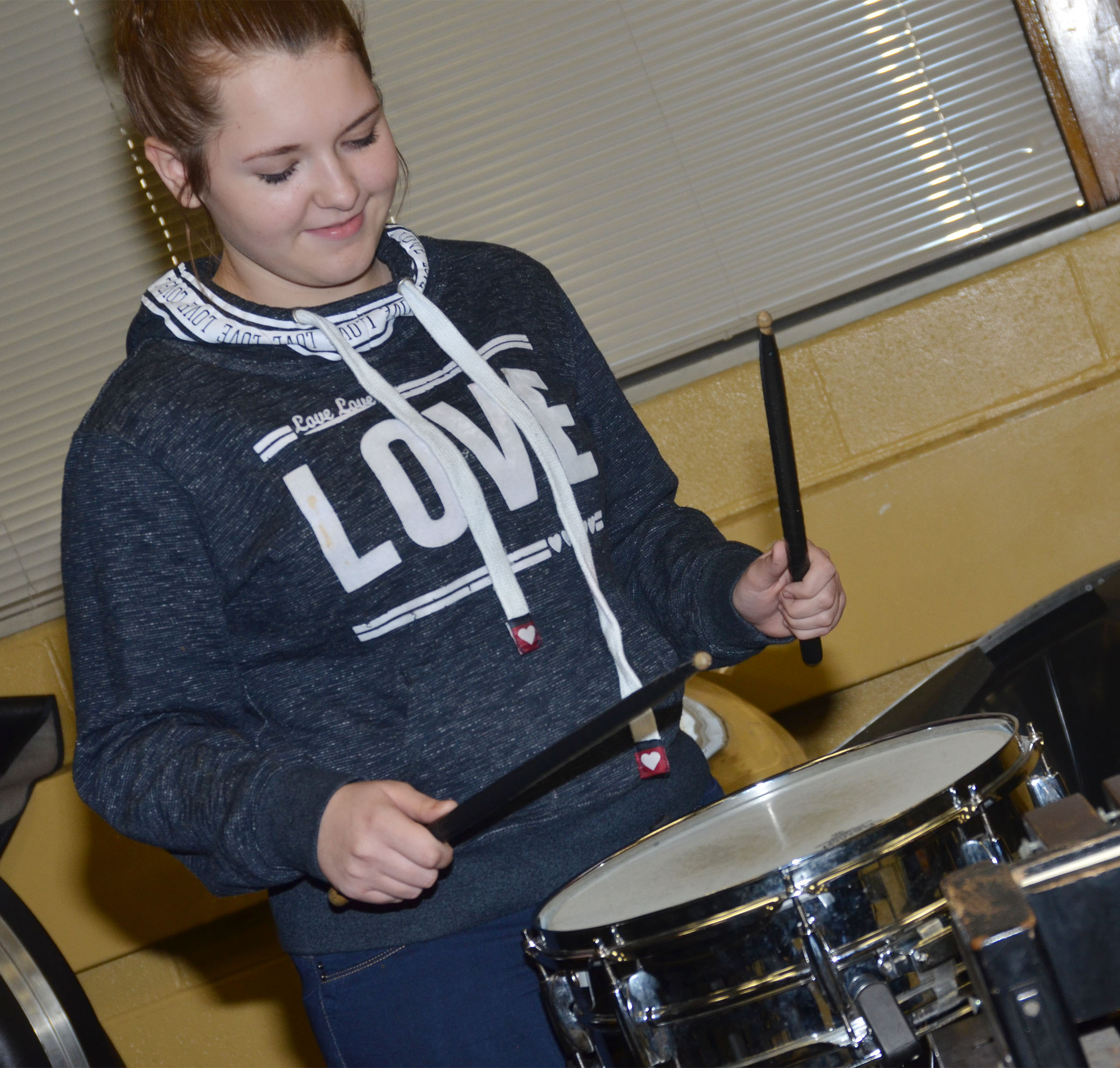 CMS eighth-grader Jasmine Davis plays the snare drum.