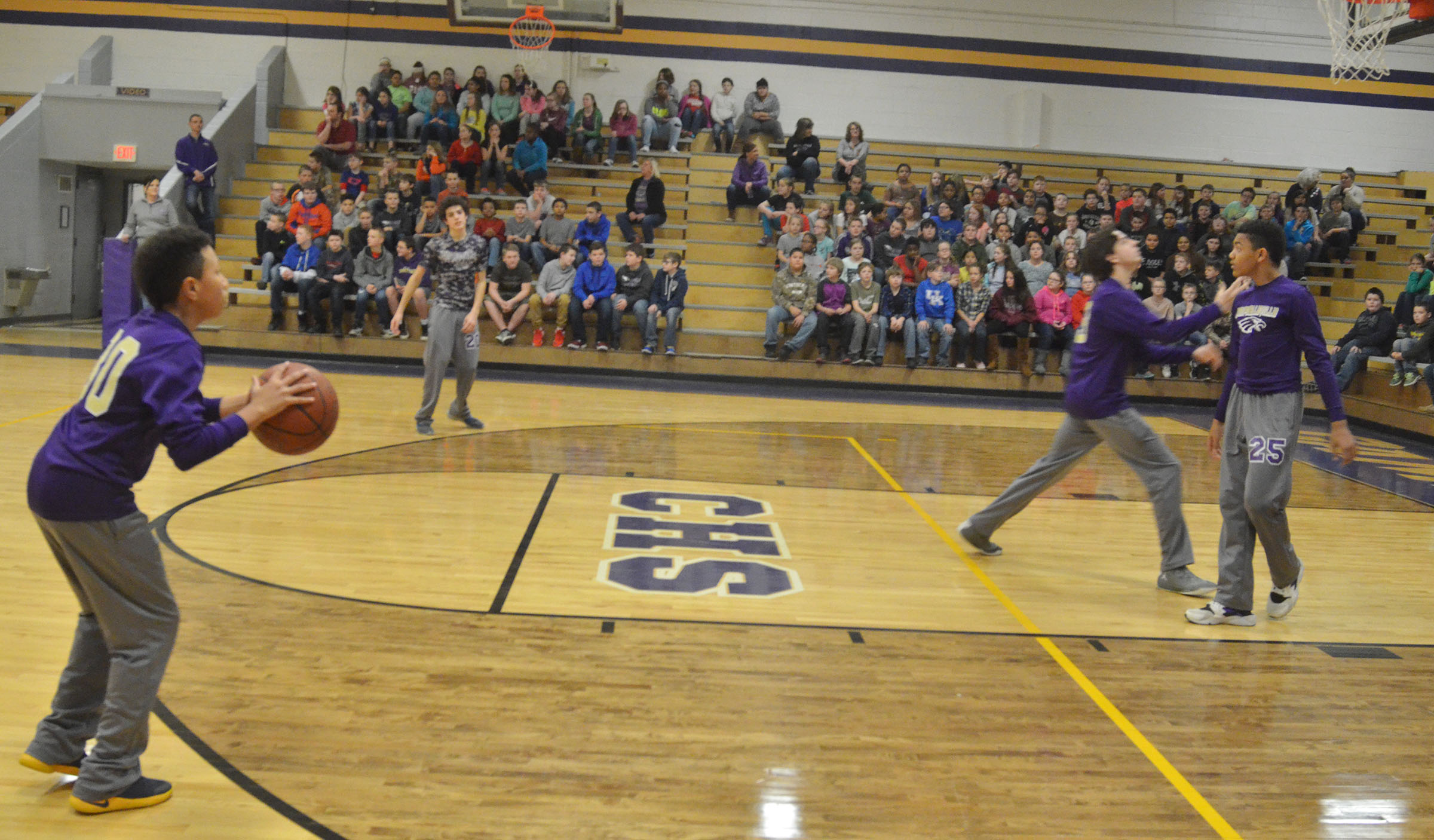 CMS boys' basketball players compete in a spirit game. Eighth-grader Jastyn Shively shoots the ball.