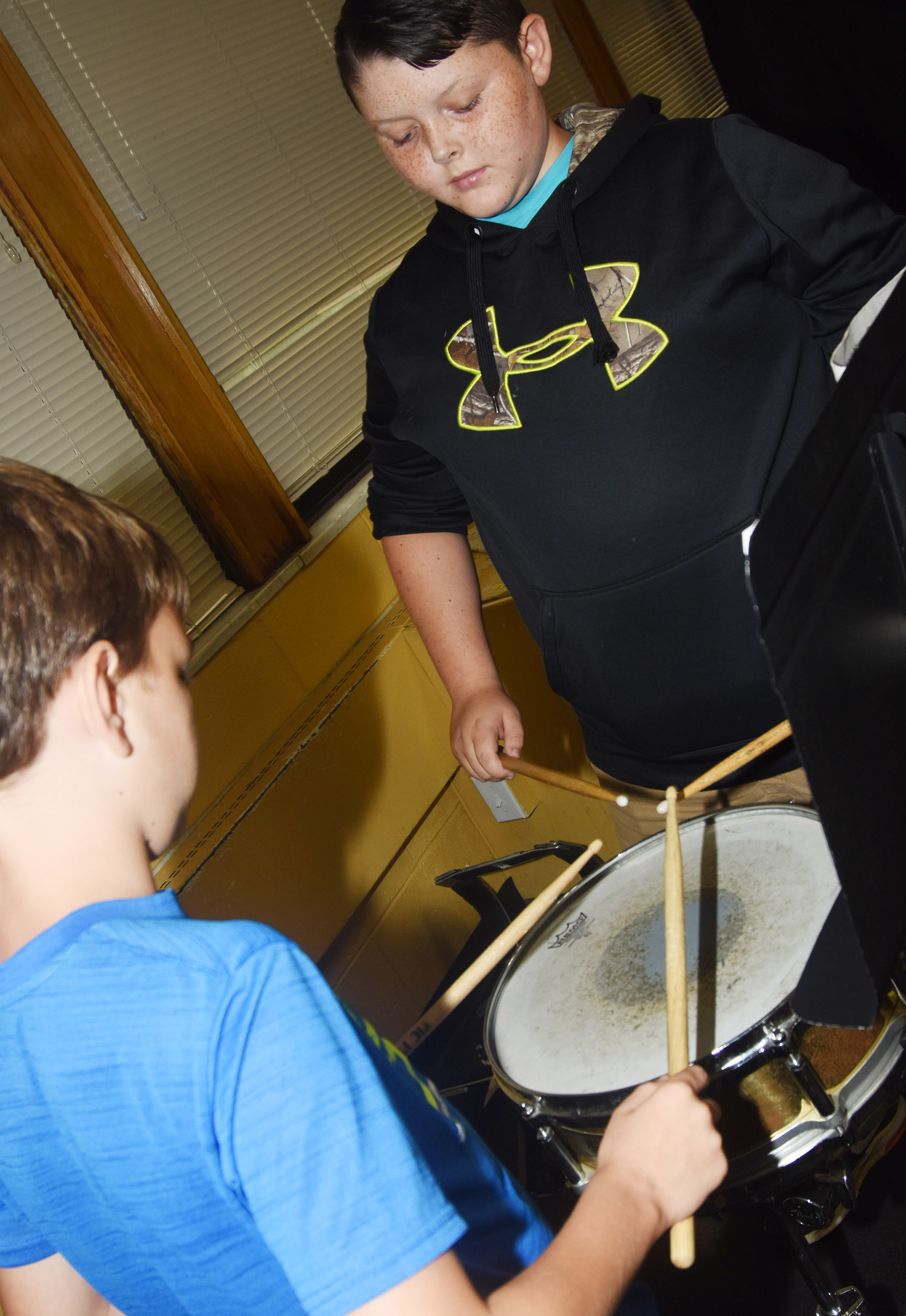 CMS sixth-graders Taylan Hunt, at left, and Matthew Humphress play the snare drum.
