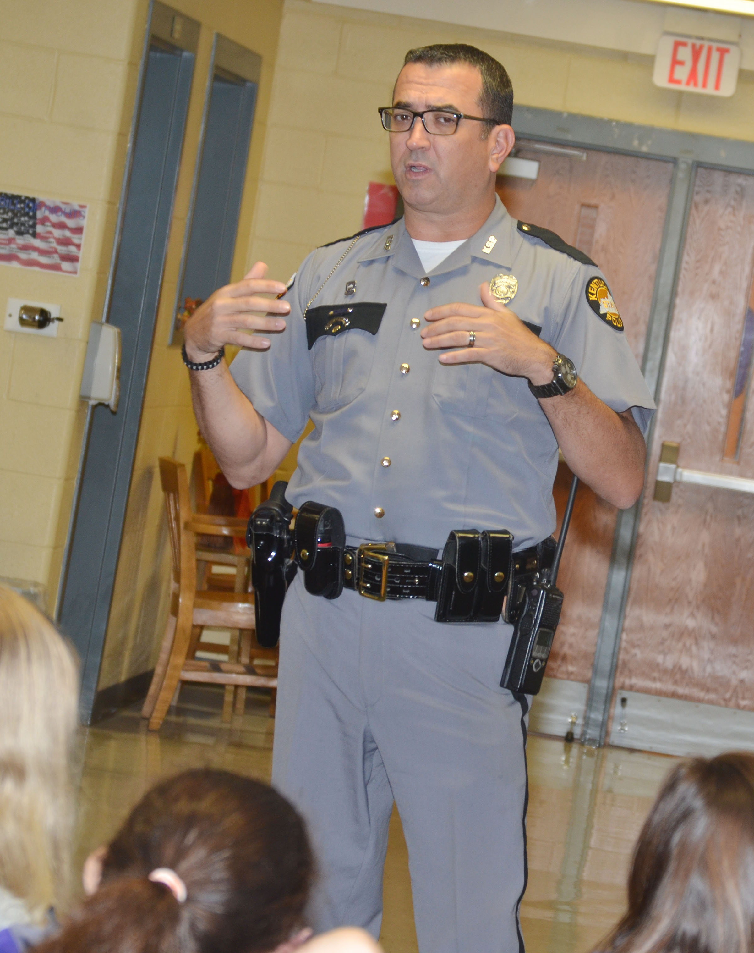 Kentucky State Police Public Affairs Officer Billy Gregory speaks to CMS sixth-graders about his job in law enforcement and the Sept. 11 terrorist attacks.