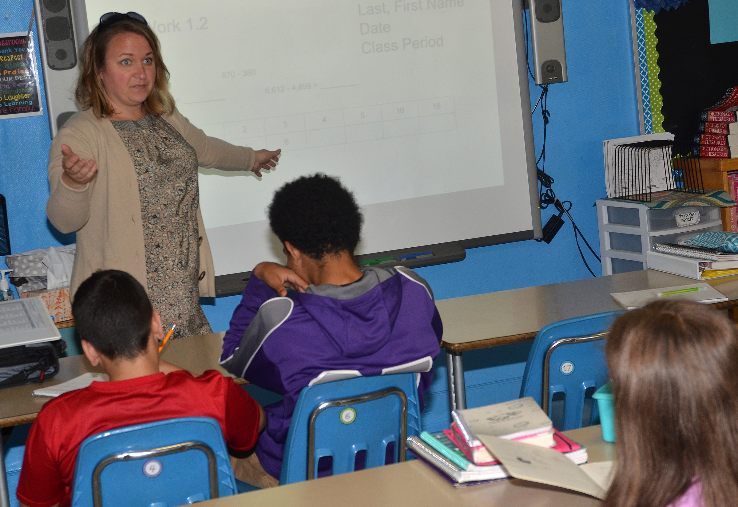 CMS teacher Katie Campbell talks to her students about finding the mean of a set of numbers.