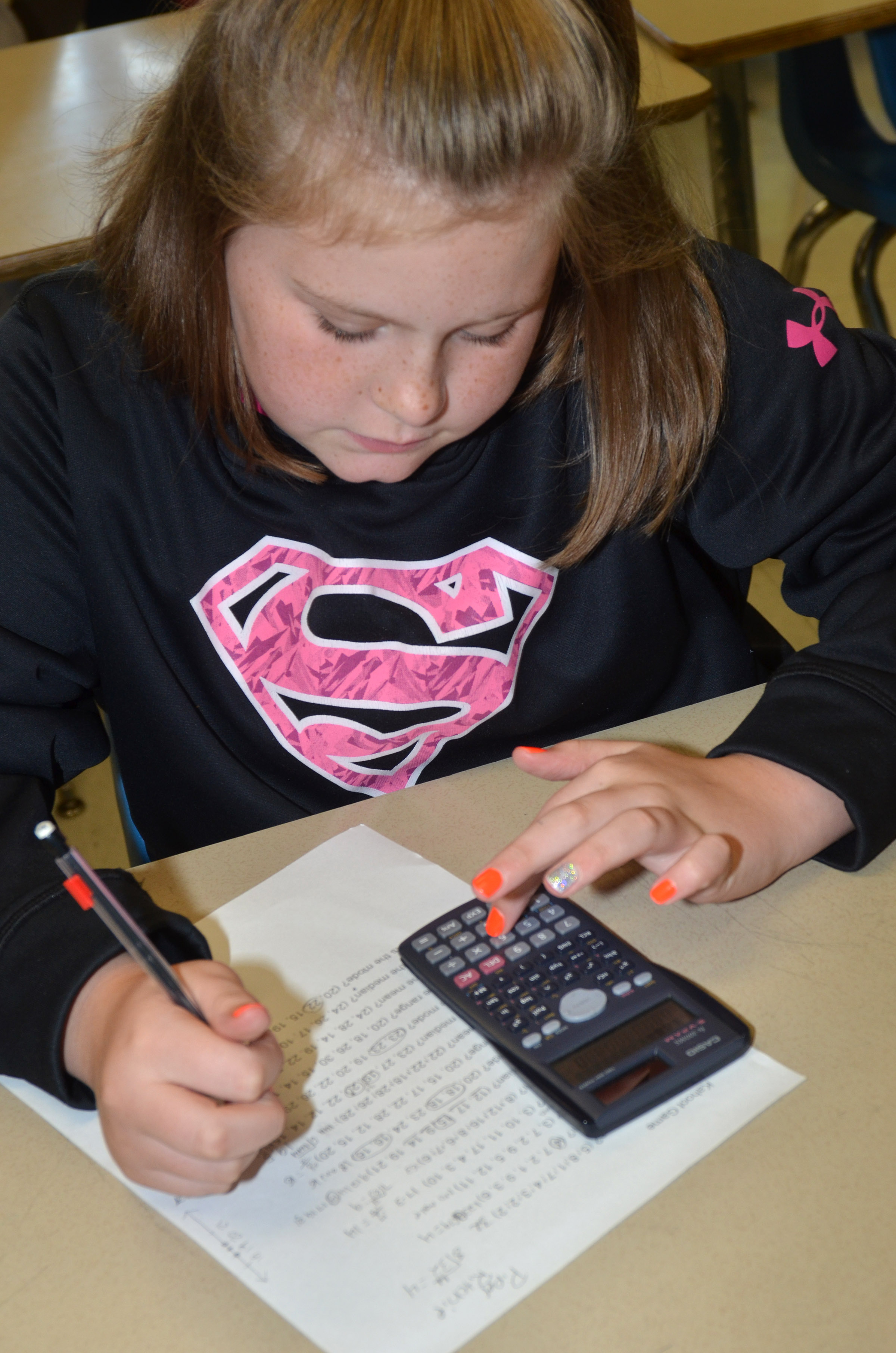 CMS sixth-grader Piper Ritchie works a math problem.