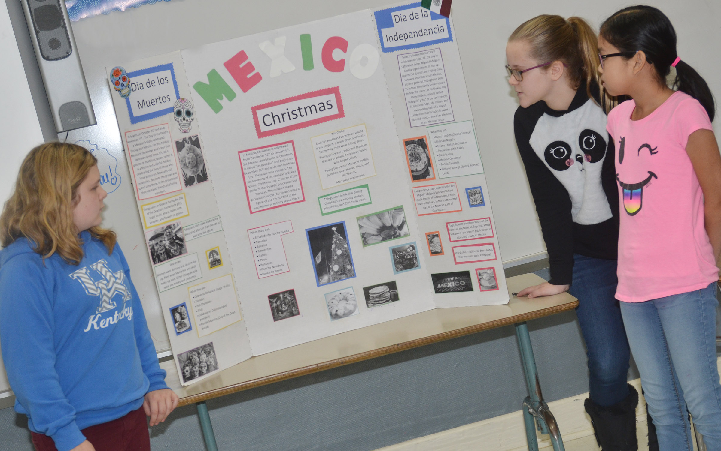 From left, CMS sixth-graders Alexis Sharp, Karlie Cox and Angelica Seng present about holiday traditions in Mexico.