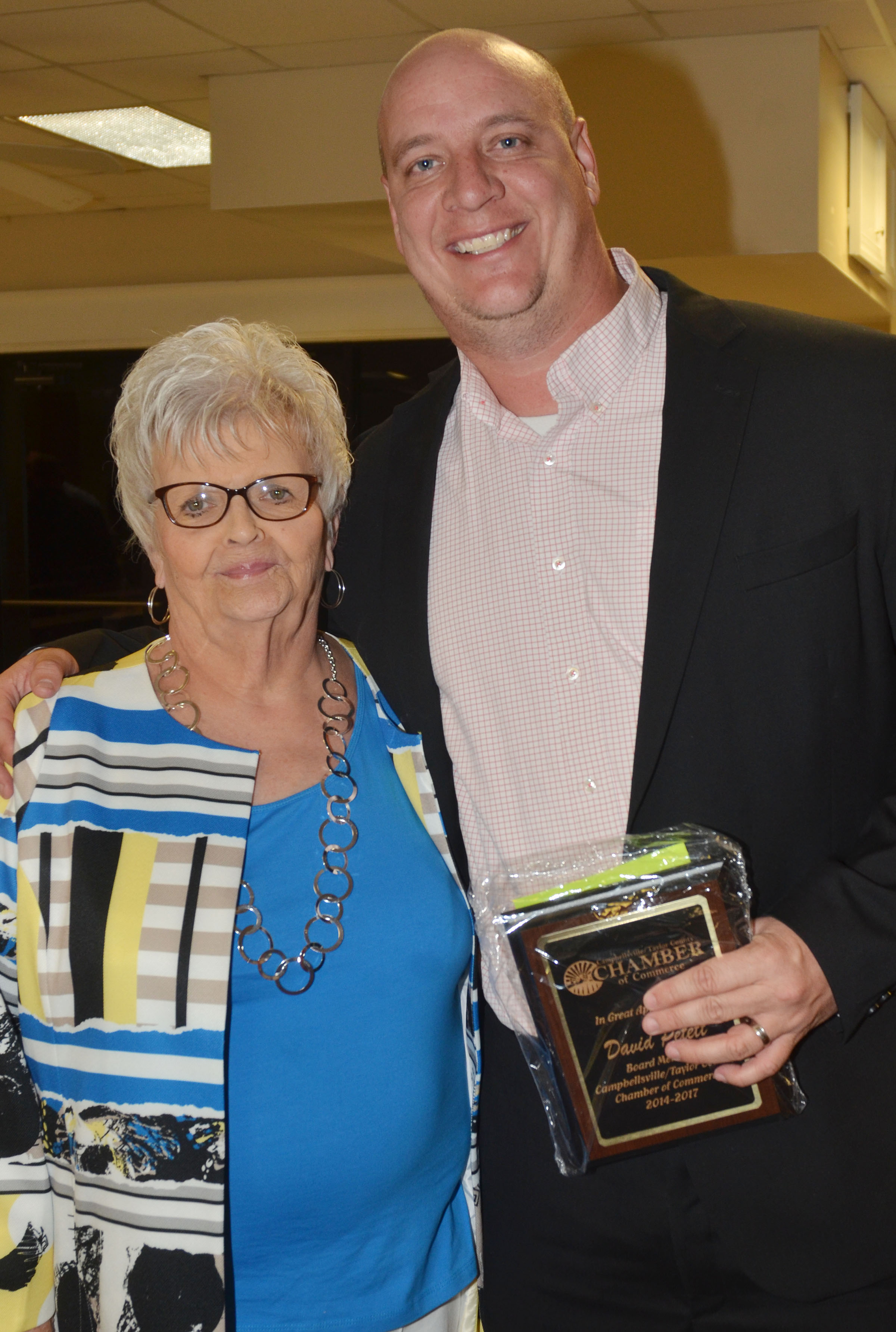 David Petett, who is transportation director and director of district programs at Campbellsville Independent Schools, was honored for serving on the Chamber Board of Directors for three years. He is pictured with Chamber Director Judy Cox.