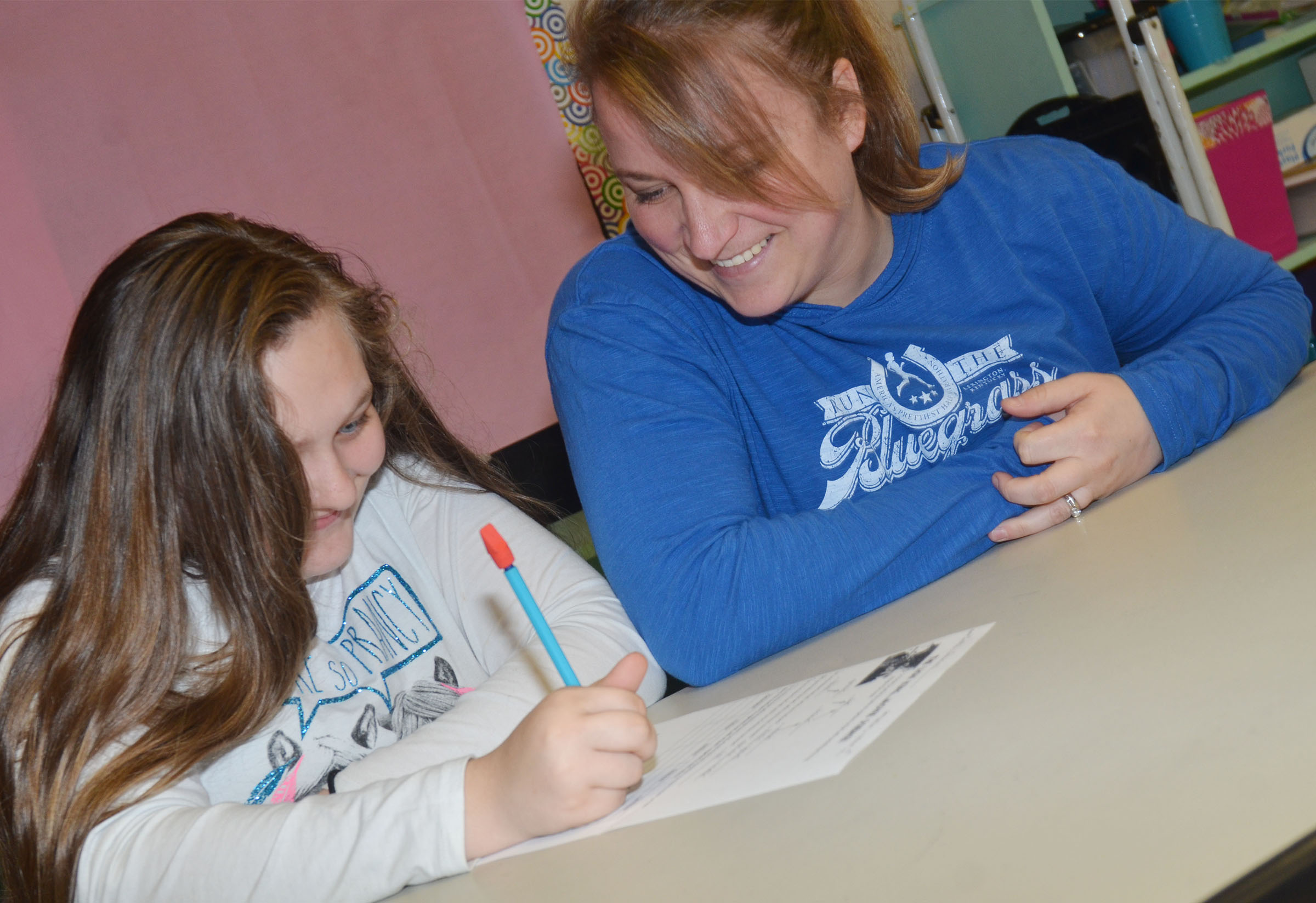 Katie Campbell, an exceptional child educator at CMS, is one of four teachers nominated for this year's Campbellsville/Taylor County Chamber of Commerce Educator of the Year award. Above, she works with sixth-grader Elizabeth Lopez.