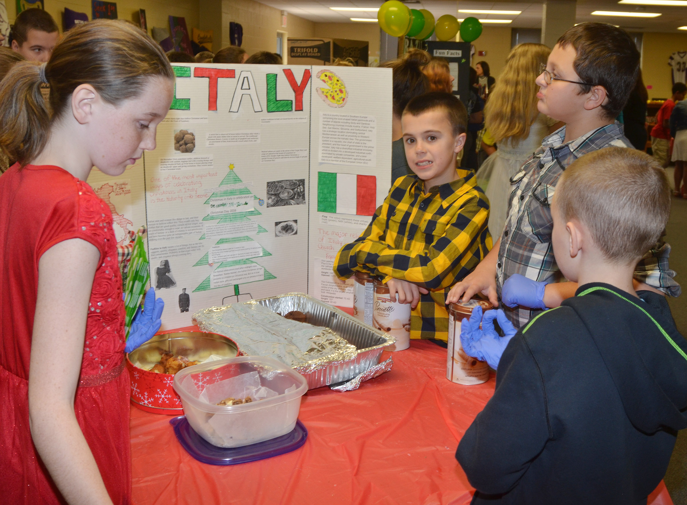 CMS sixth-grader Chase Hord and his classmates present about Christmas traditions in Italy.