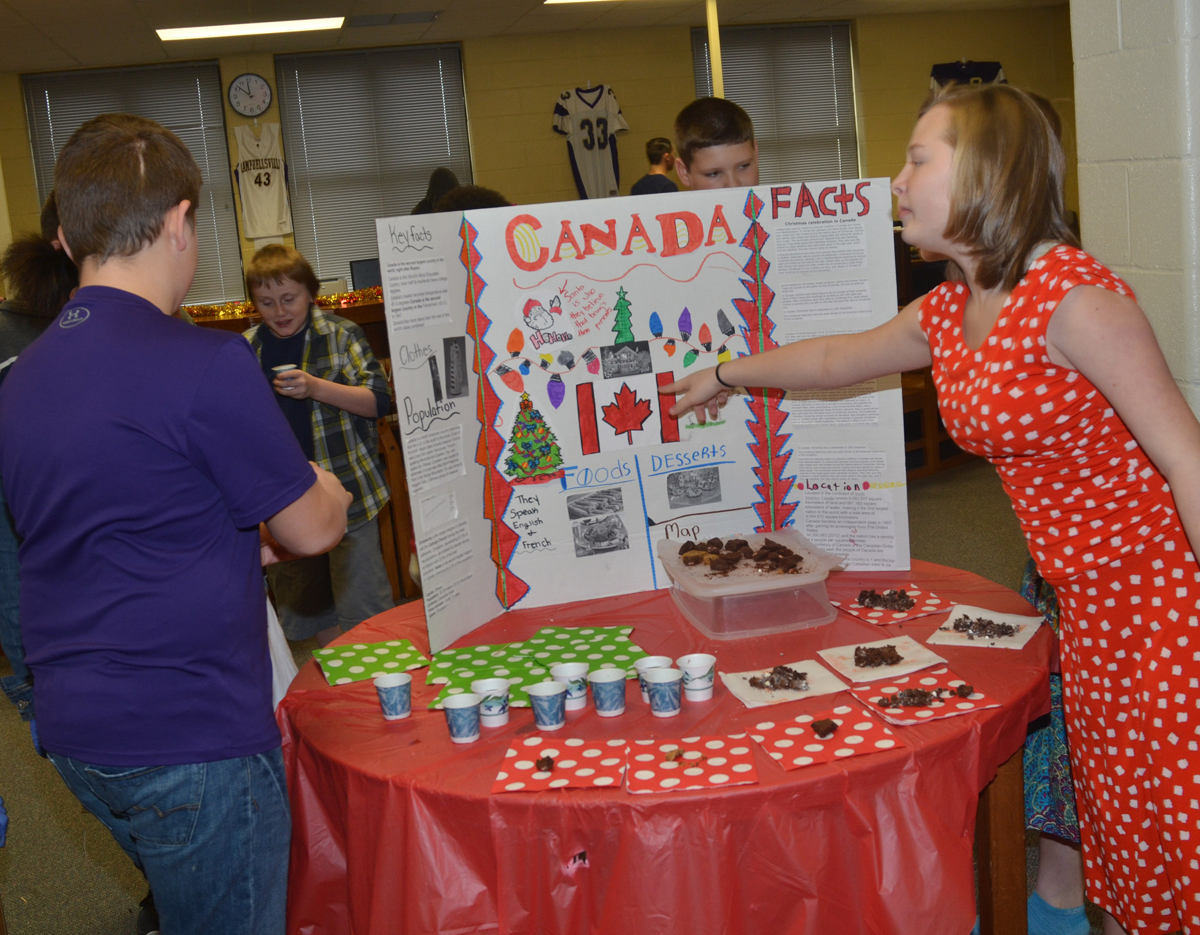 CMS sixth-grader Davanna Reardon presents about Christmas traditions in Canada.
