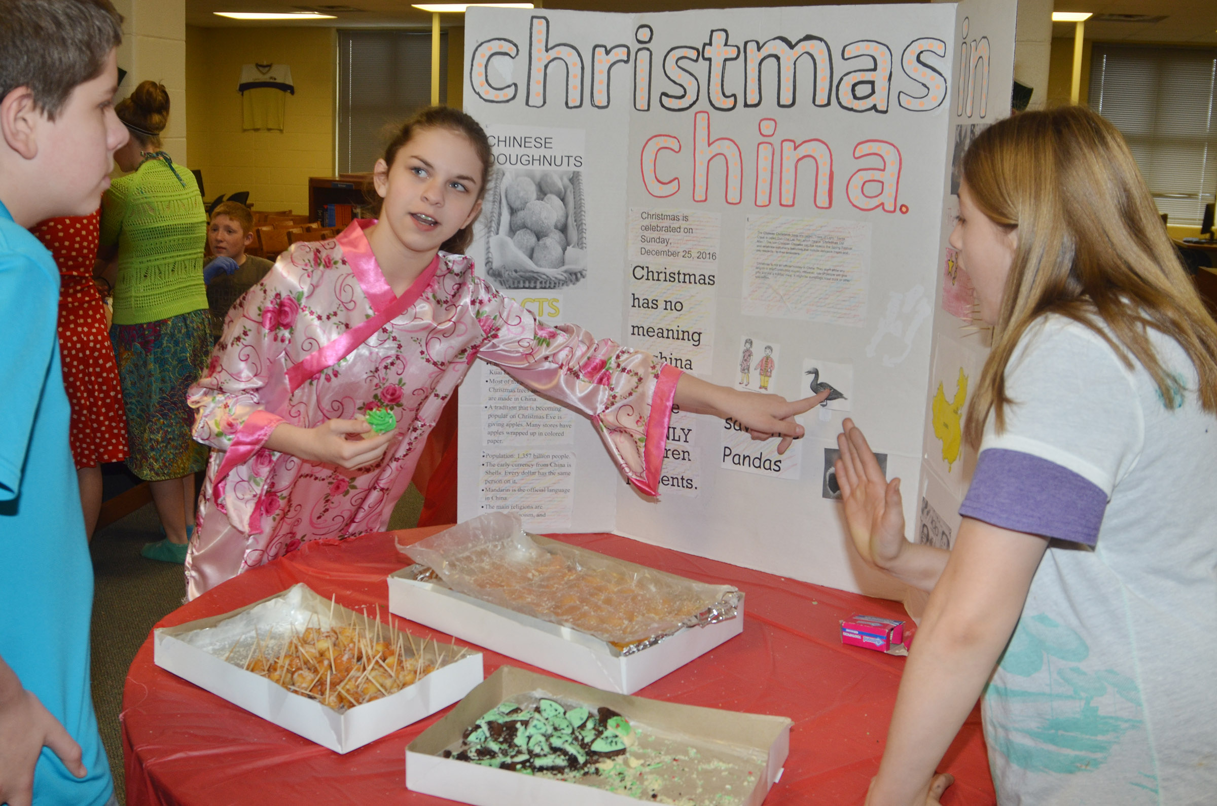 CMS sixth-grader Karlee Rakel presents about Christmas traditions in China.