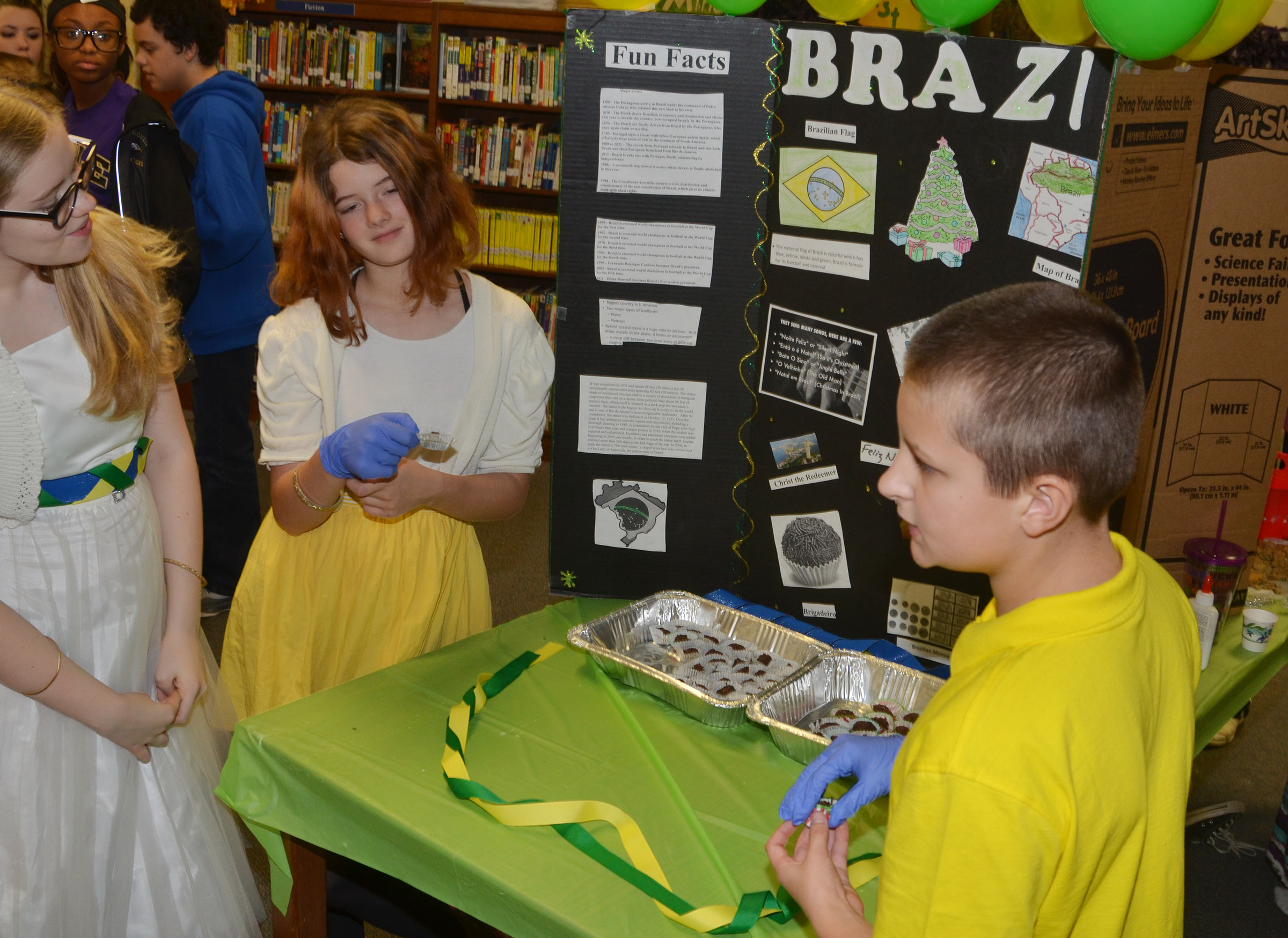 CMS sixth-graders Whitney Frashure, at left, and Leah Parker present about Christmas traditions in Brazil.