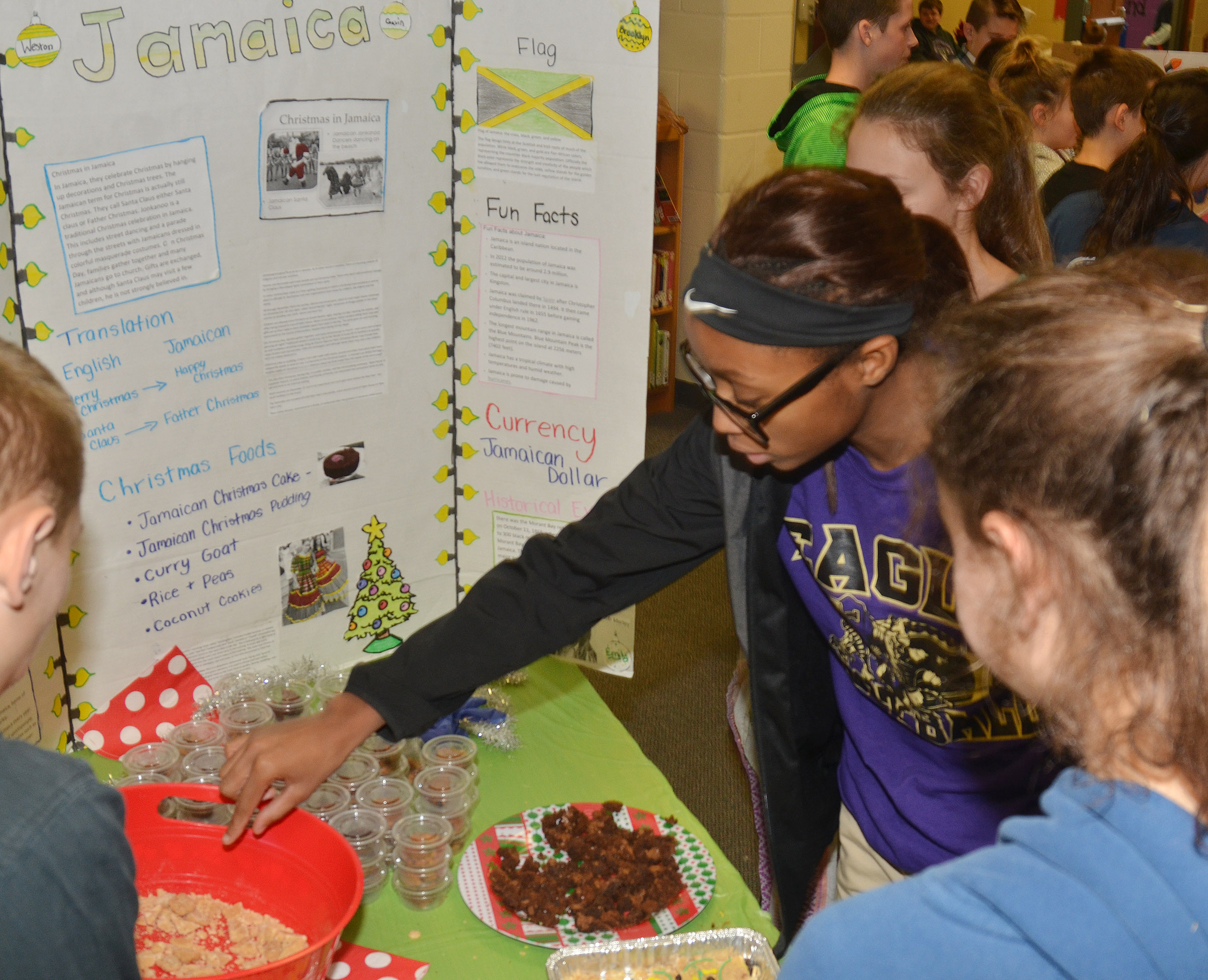 CMS seventh-grader Bri Gowdy samples foods commonly served in Jamaica at Christmas.