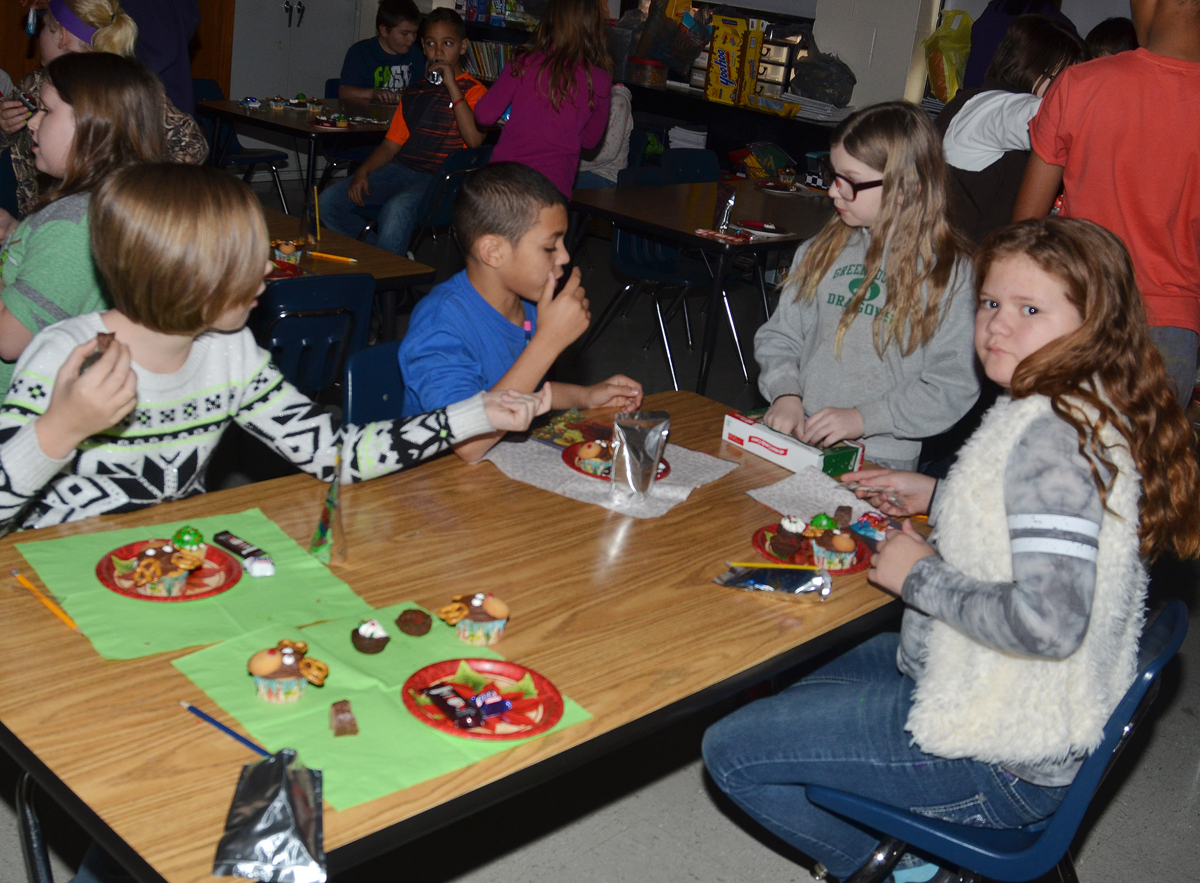CMS fourth-graders have fun at their Christmas party.