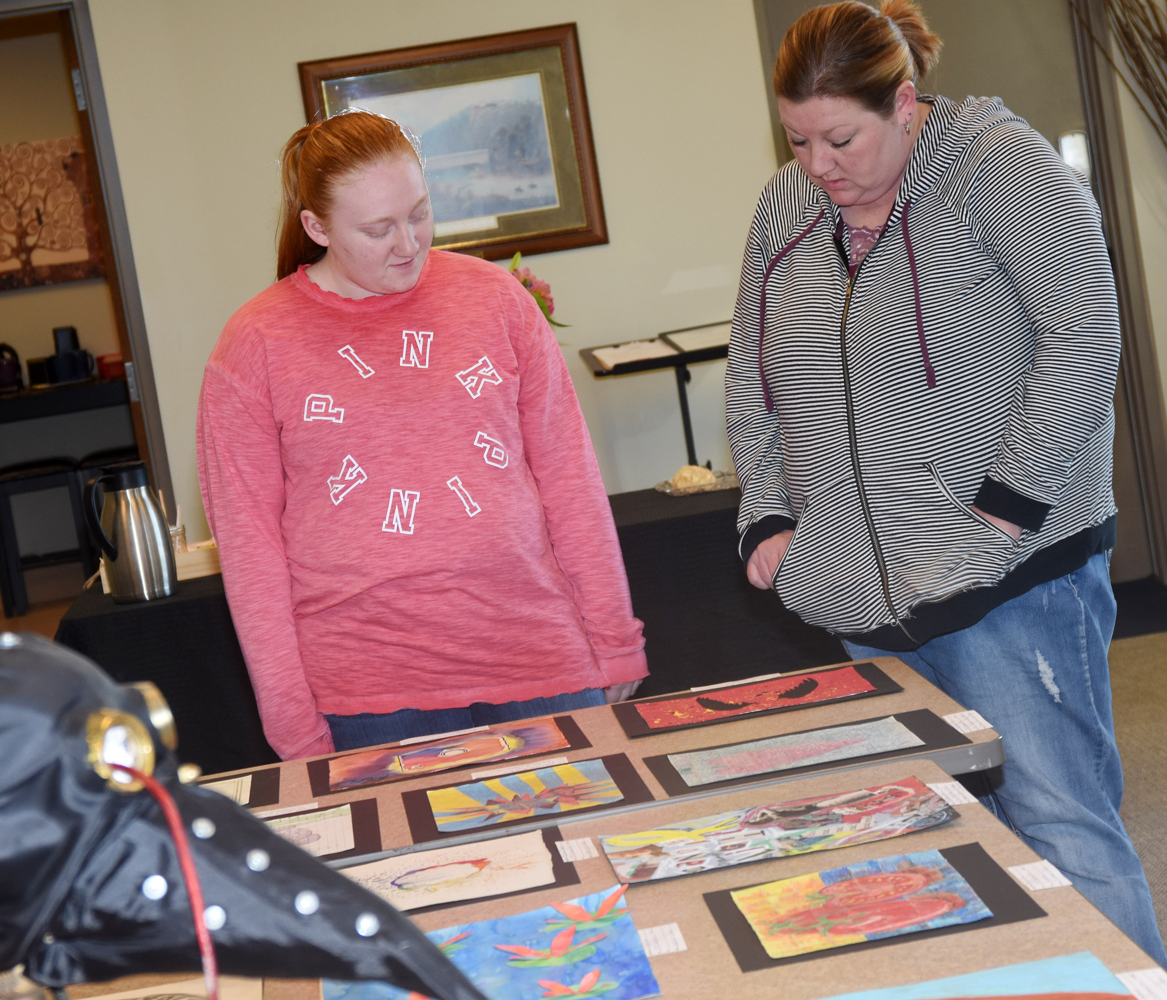 CHS sophomore Haleigh Murphy shows her mother Beth her artwork.
