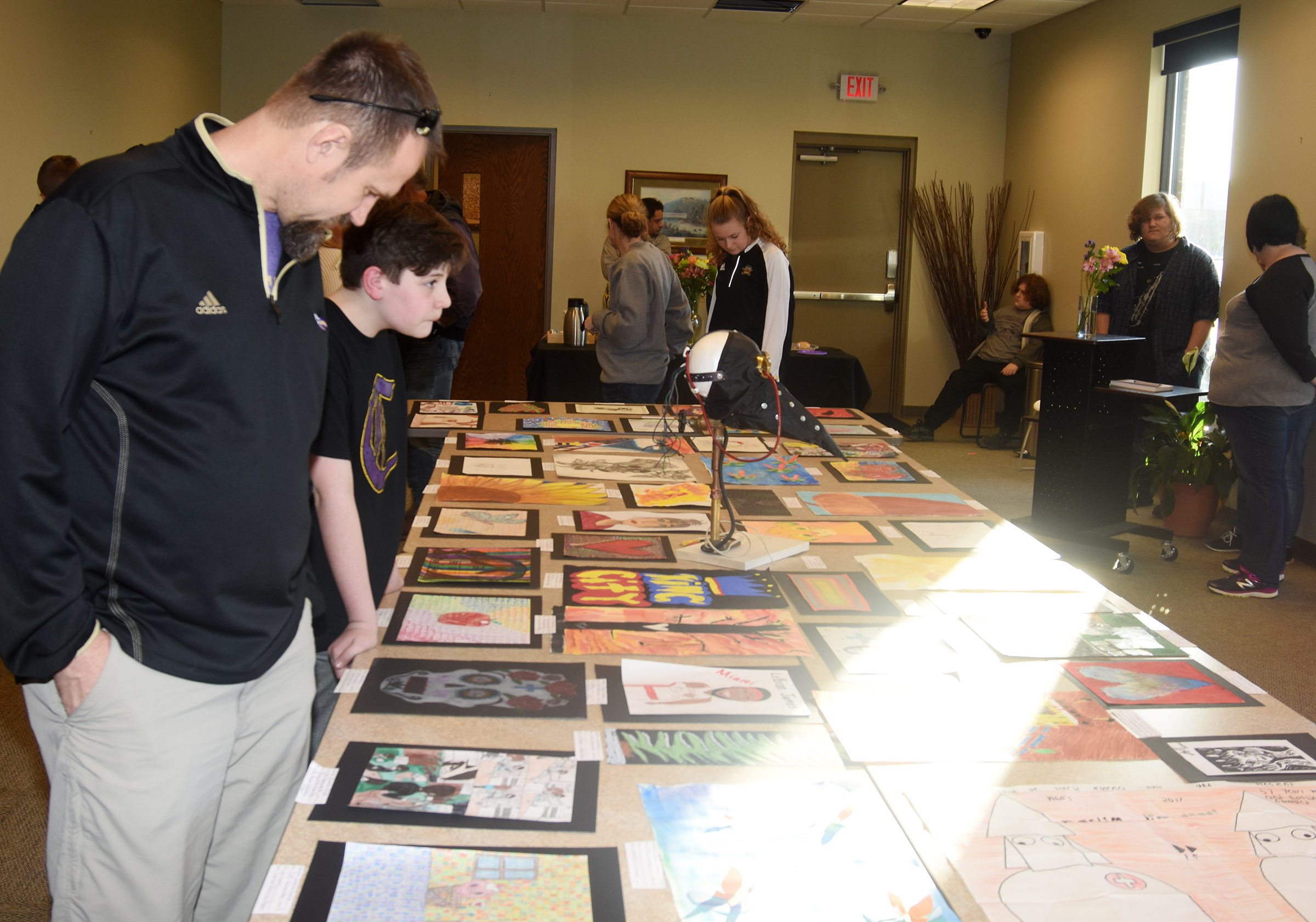 CHS Exceptional Child Educator Steve Doss looks at artwork.