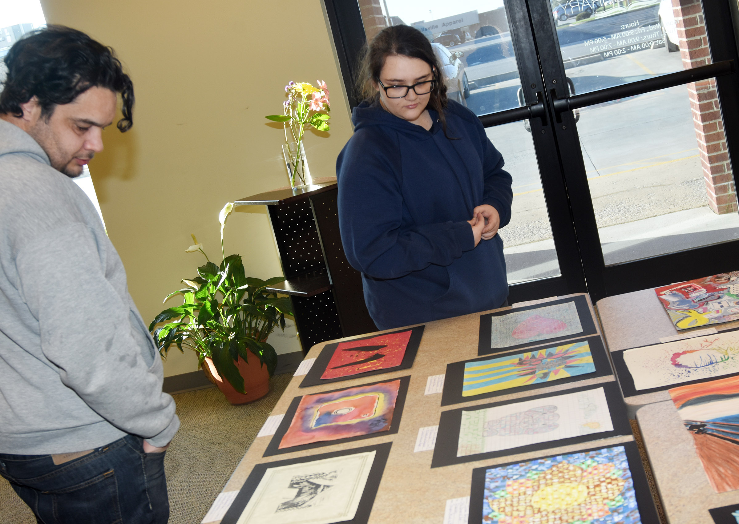 CHS freshman Haley Lopez looks at the artwork on display.
