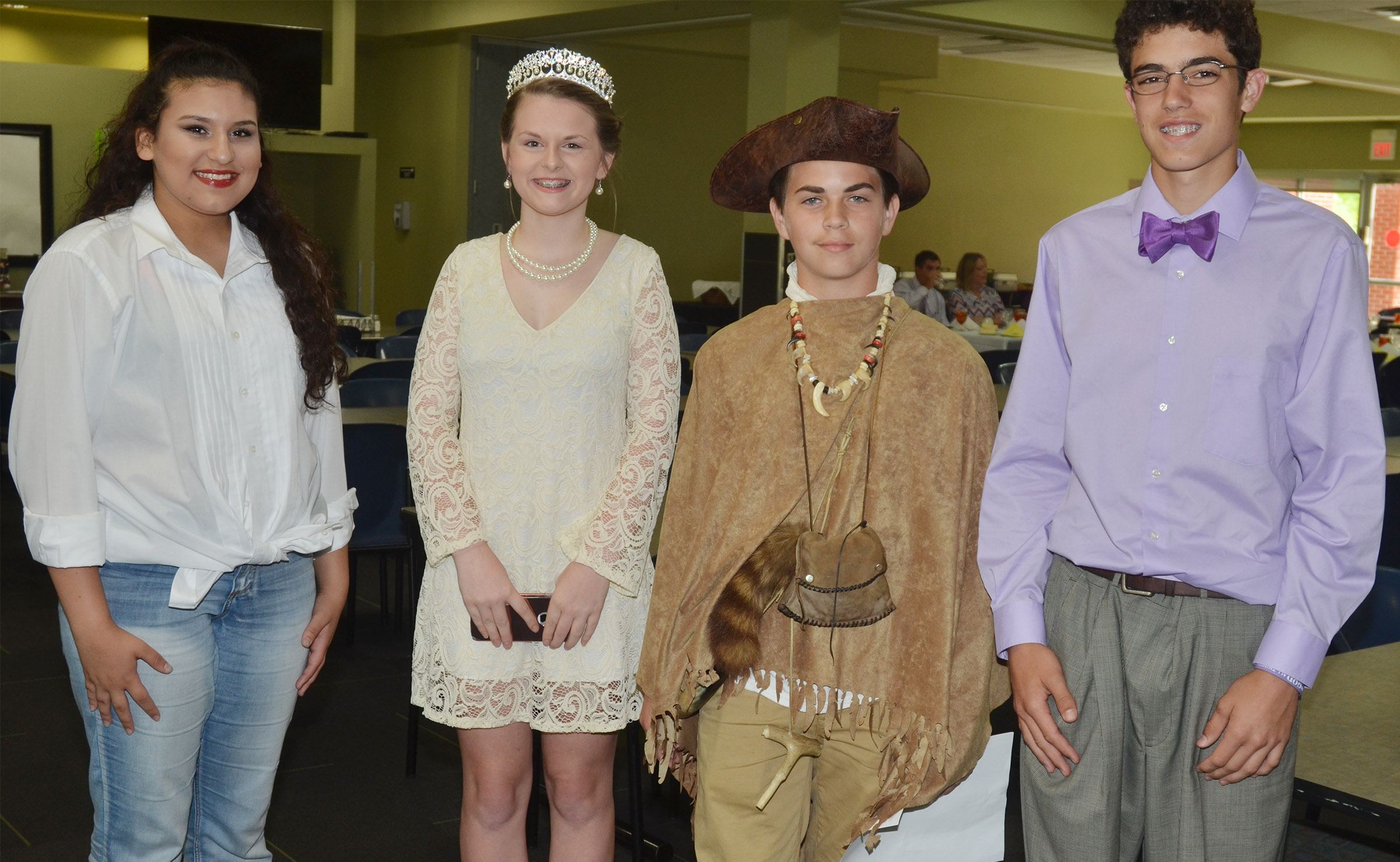 CMS eighth-graders recently completed Campbellsville University's leadership program, and, at a banquet in their honor, portrayed historical characters. From left are Anna Clara Moura portraying Salena, Taylor Knight portraying Princess Diana, Clark Kidwell portraying William Clark and Kameron Smith portraying Franklin D. Roosevelt.
