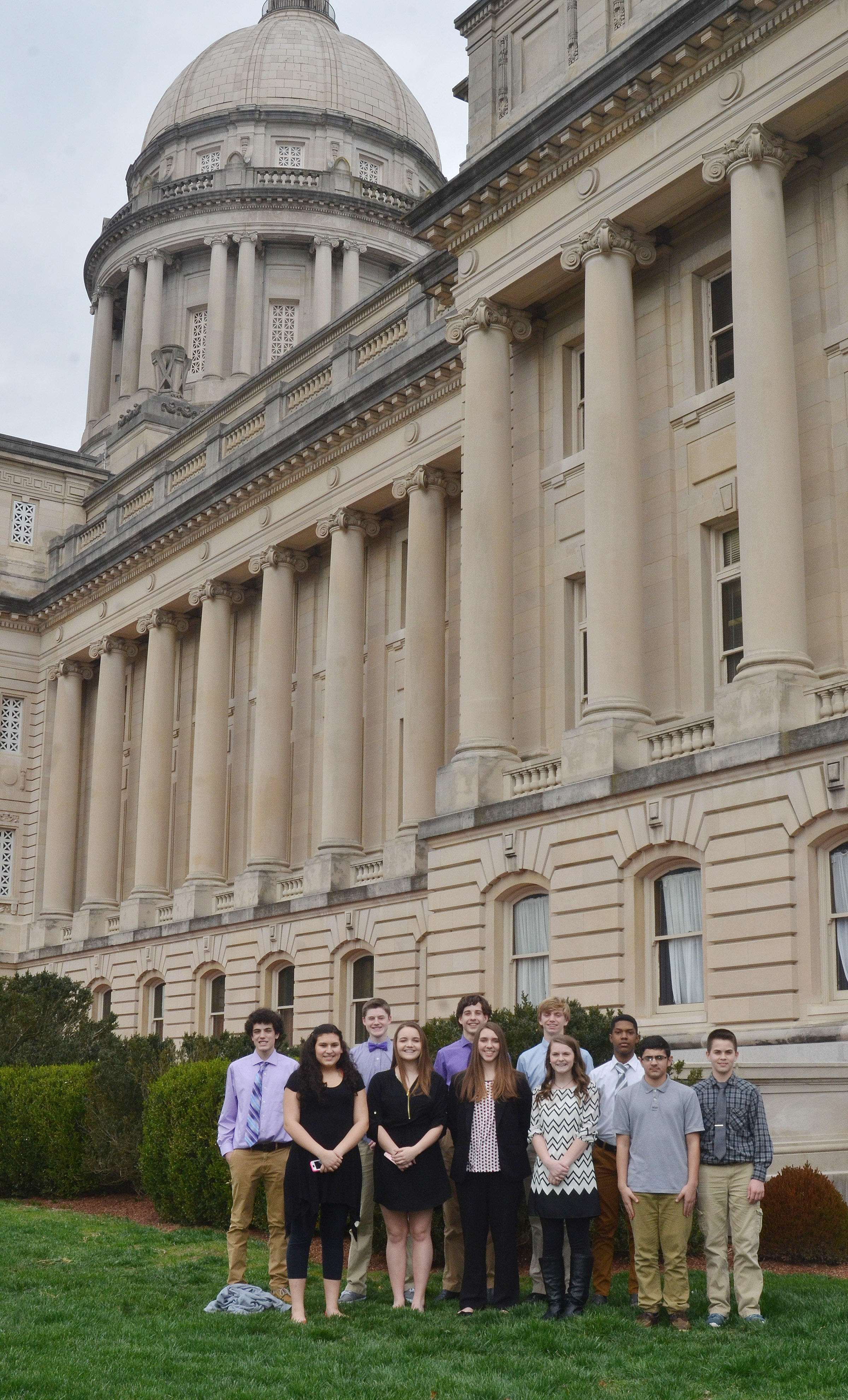 CMS CU leadership students pose for a photo outside the Kentucky capitol. From left, front, are Anna Clara Moura, Kenzi Forbis, Abi Wiedewitsch, Taylor Knight, Hassan Alabusalim and Clark Kidwell. Back, Kameron Smith, Tristin Faulkner, John Orberson, Arren Hash and Zaquan Cowan.