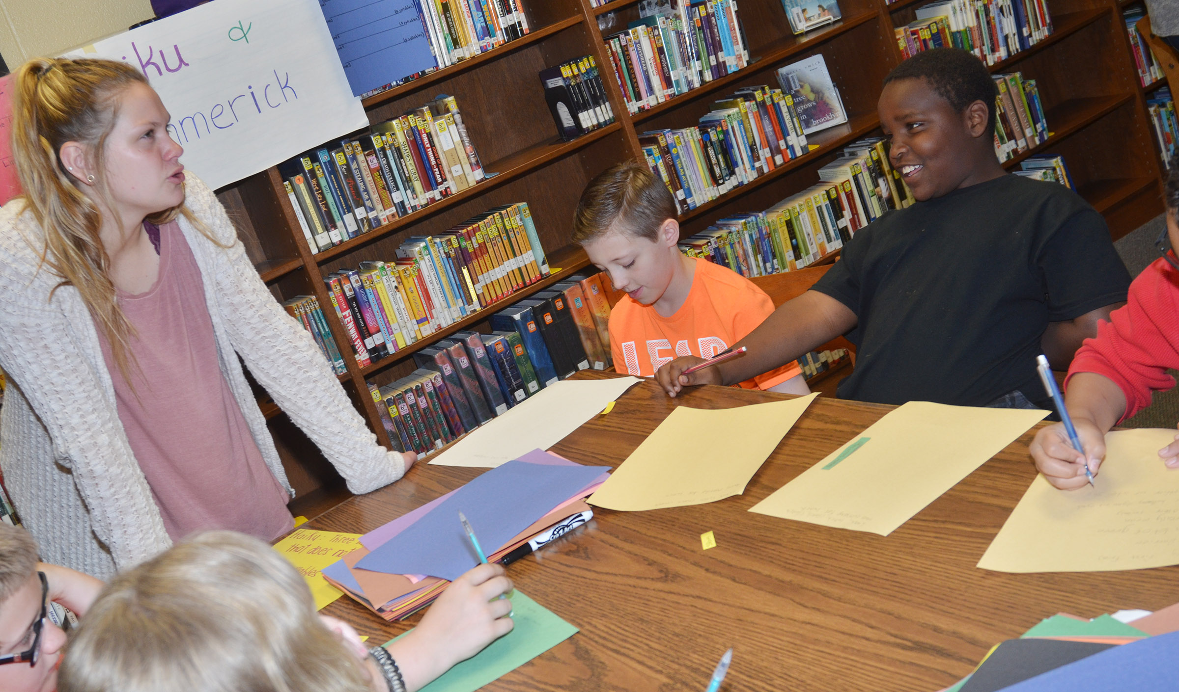 CMS fourth-graders Jaxon Garrett, at left, and Temarieon Warren write their haikus.