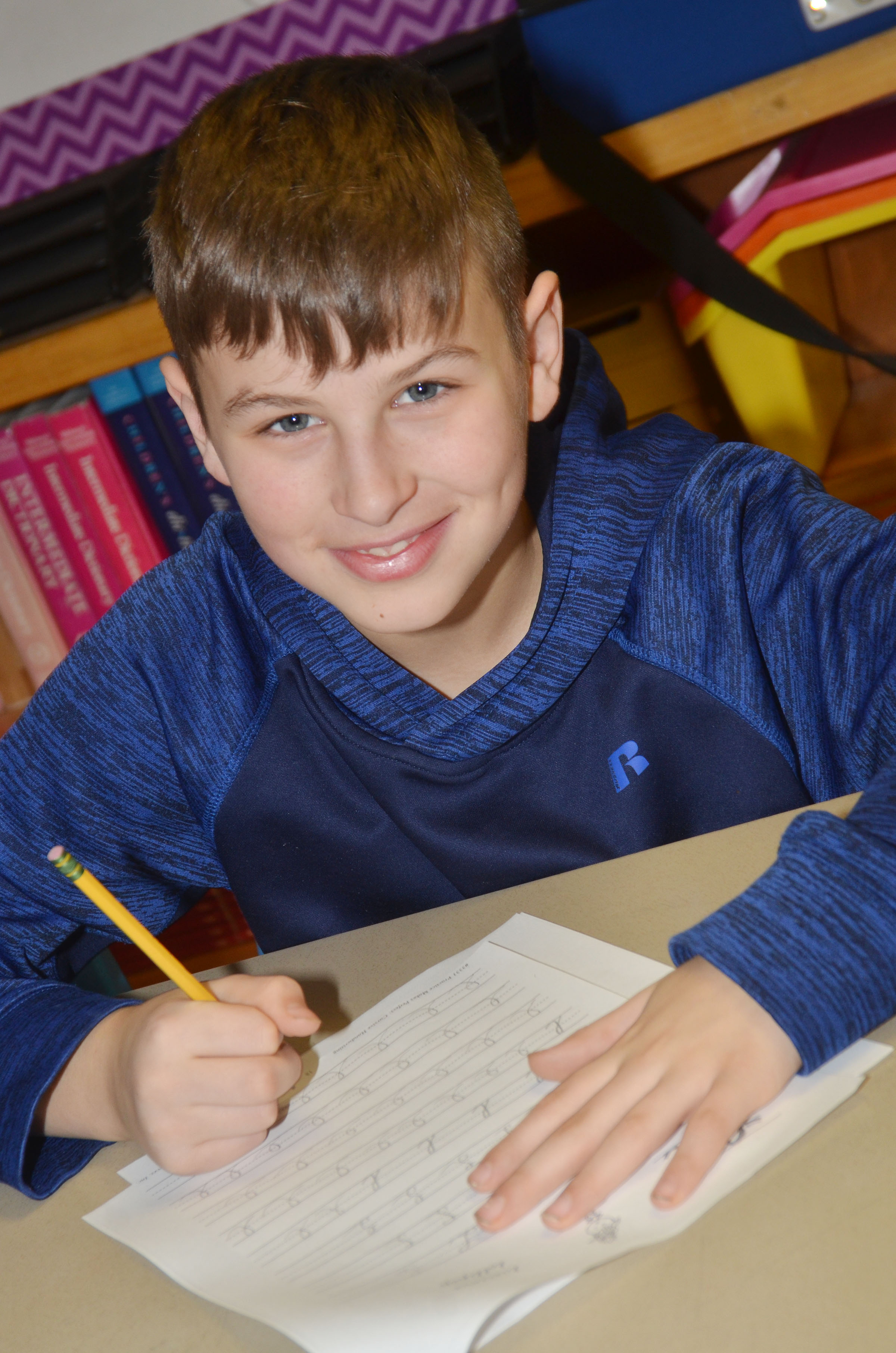 CMS fifth-grader Jaxon Sidebottom practices cursive writing.