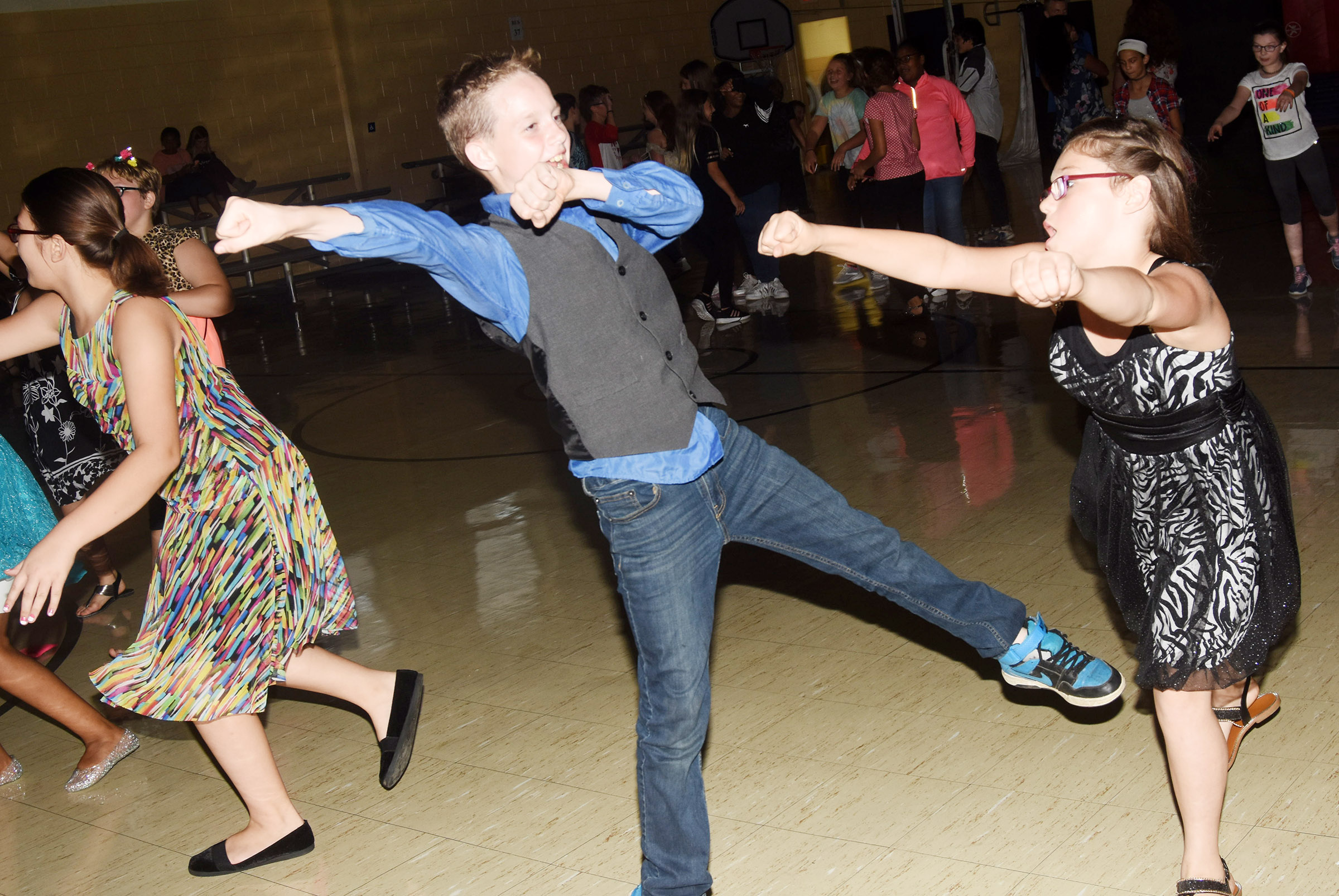 CMS sixth-grader Will Wooley, at left, and Destiny Milby dance.